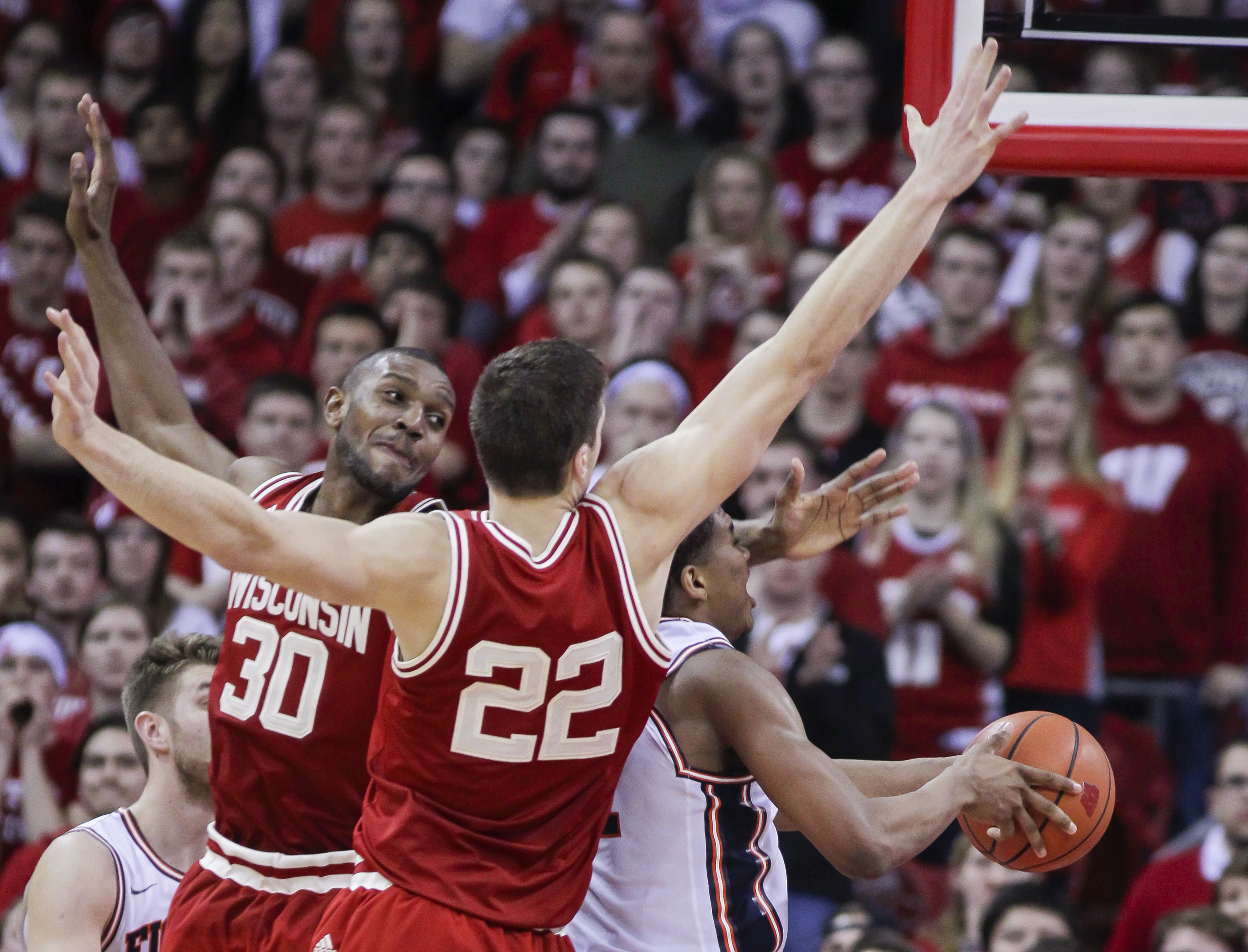 Wisconsin's Vitto Brown (30) and Ethan Happ (22) block out Illinois' Malcolm Hill (21) during the second half of an NCAA college basketball game Sunday, Feb. 21, 2016, in Madison, Wis. Wisconsin won 69-60. (AP Photo/Andy Manis)