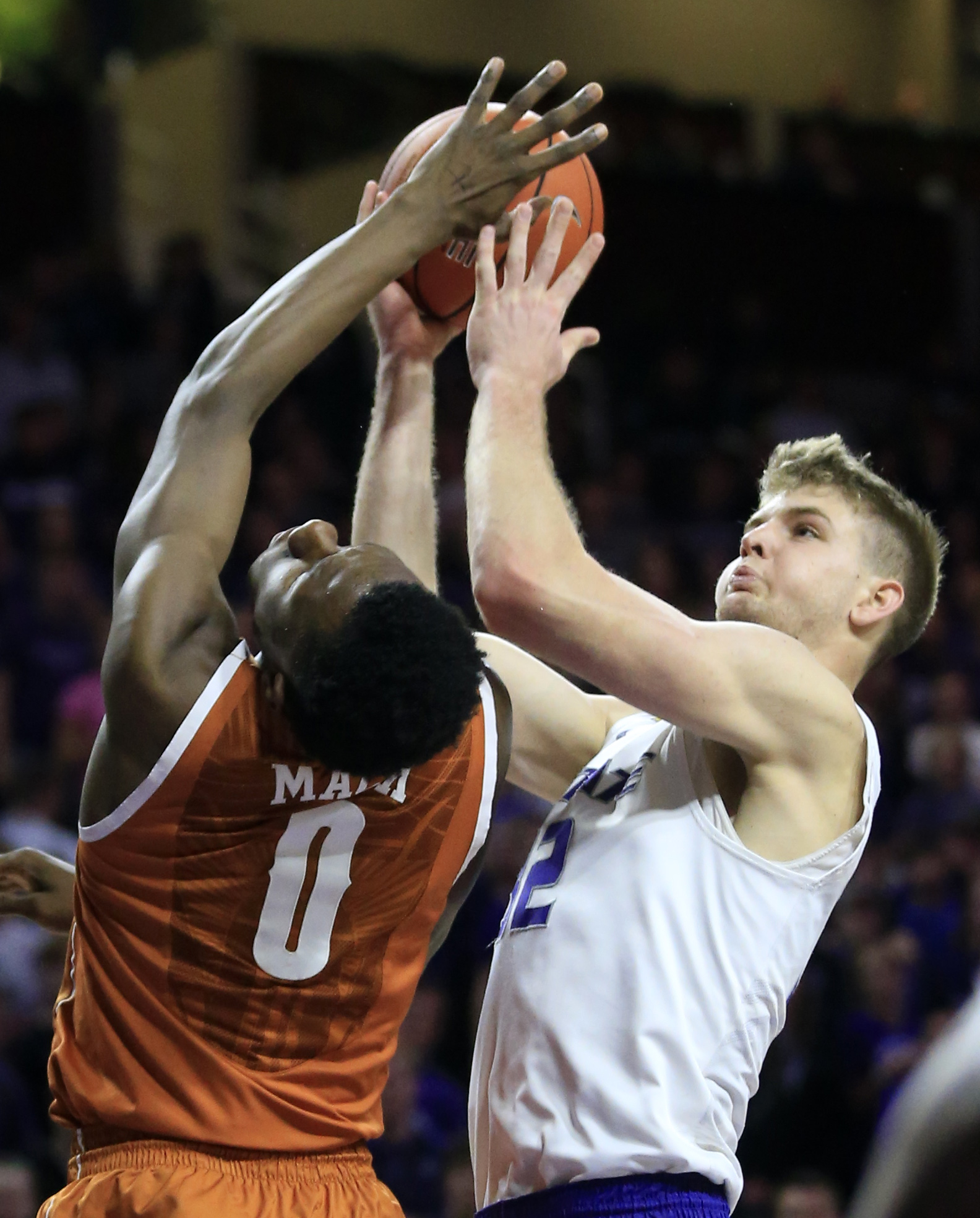 Kansas State forward Dean Wade (32) shoots while covered by Texas guard Tevin Mack (0) during the second half of an NCAA college basketball game in Manhattan, Kan., Monday, Feb. 22, 2016. (AP Photo/Orlin Wagner)
