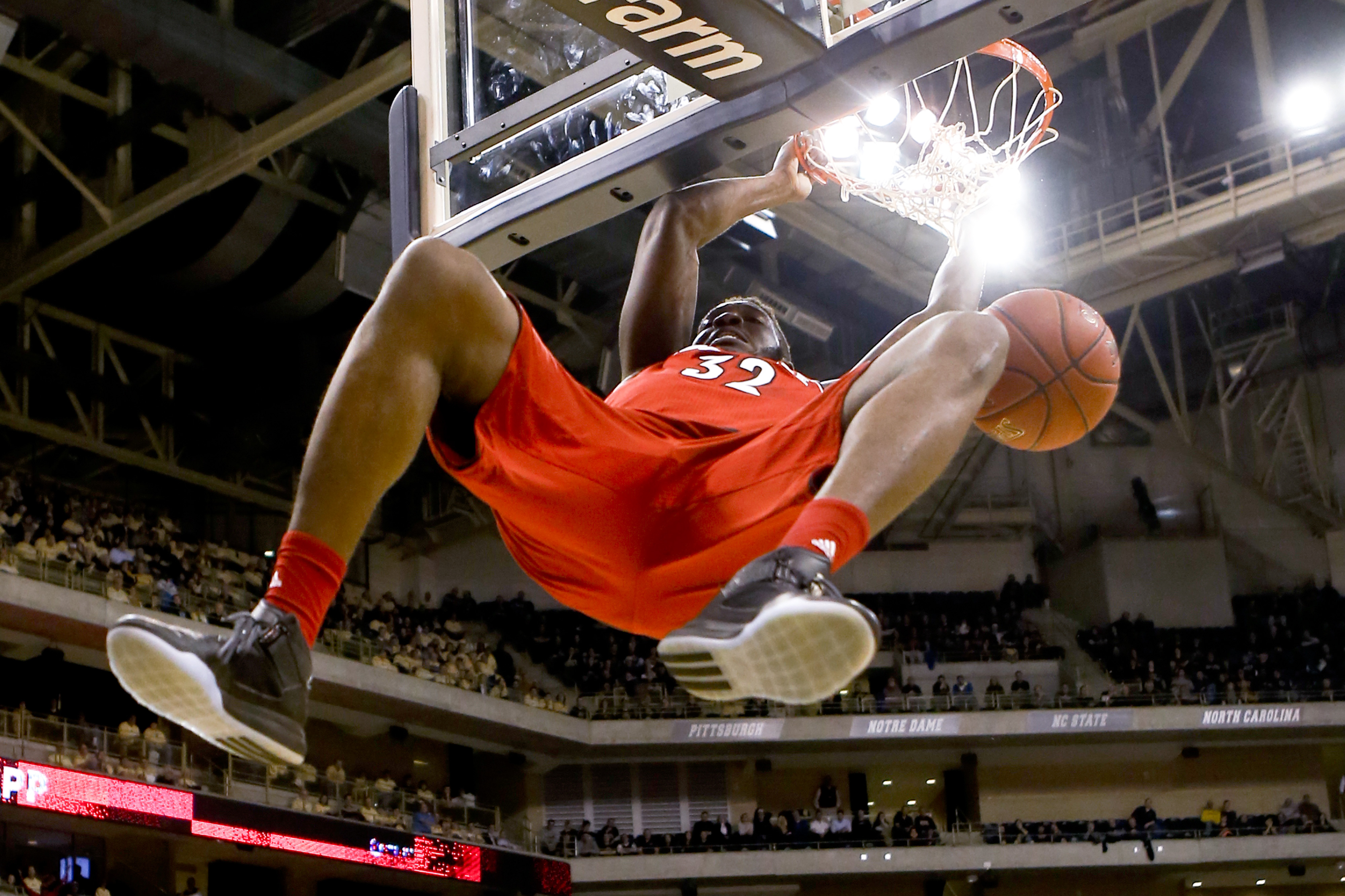 Louisville's Chinanu Onuaku (32) dunks on a break away during the first half of an NCAA college basketball game against Pittsburgh, Wednesday, Feb. 24, 2016, in Pittsburgh. (AP Photo/Keith Srakocic)