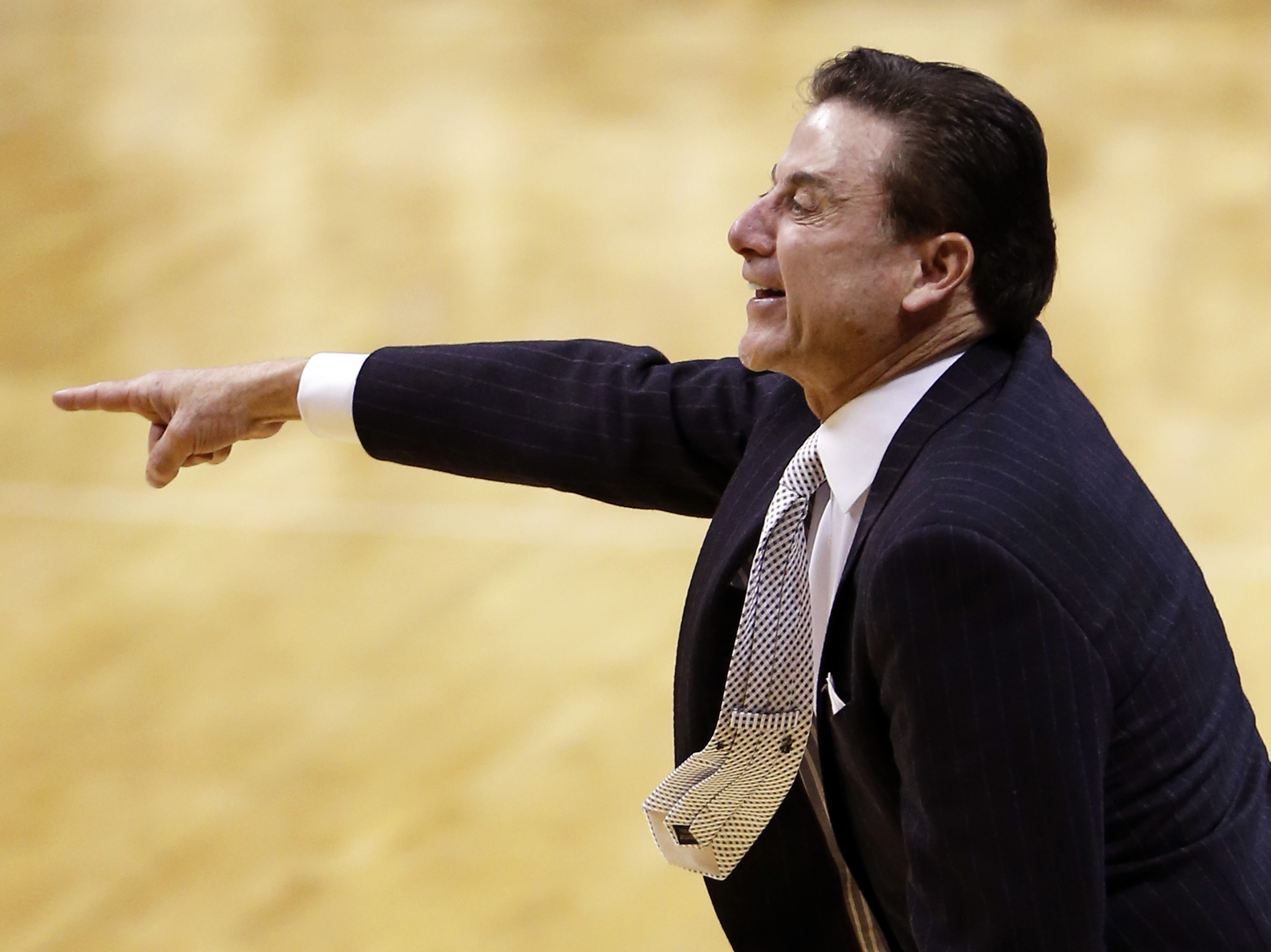 Louisville head coach Rick Pitino gives instructions to his team during the second half of an NCAA college basketball game against Pittsburgh, Wednesday, Feb. 24, 2016, in Pittsburgh. Louisville won 67-60. (AP Photo/Keith Srakocic)