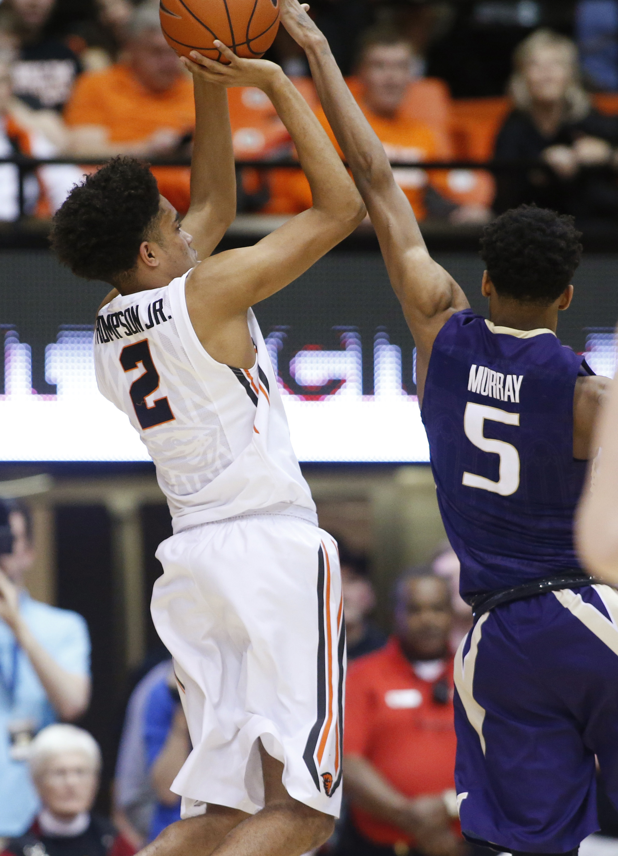 Oregon State's Stephen Thompson Jr., left, shoots a 3-pointer over Washington's Dejounte Murray at the end of an NCAA college basketball game in Corvallis, Ore., on Wednesday, Feb. 24, 2016. Thompson made the shot, giving Oregon State a 82-81 win. (AP Pho
