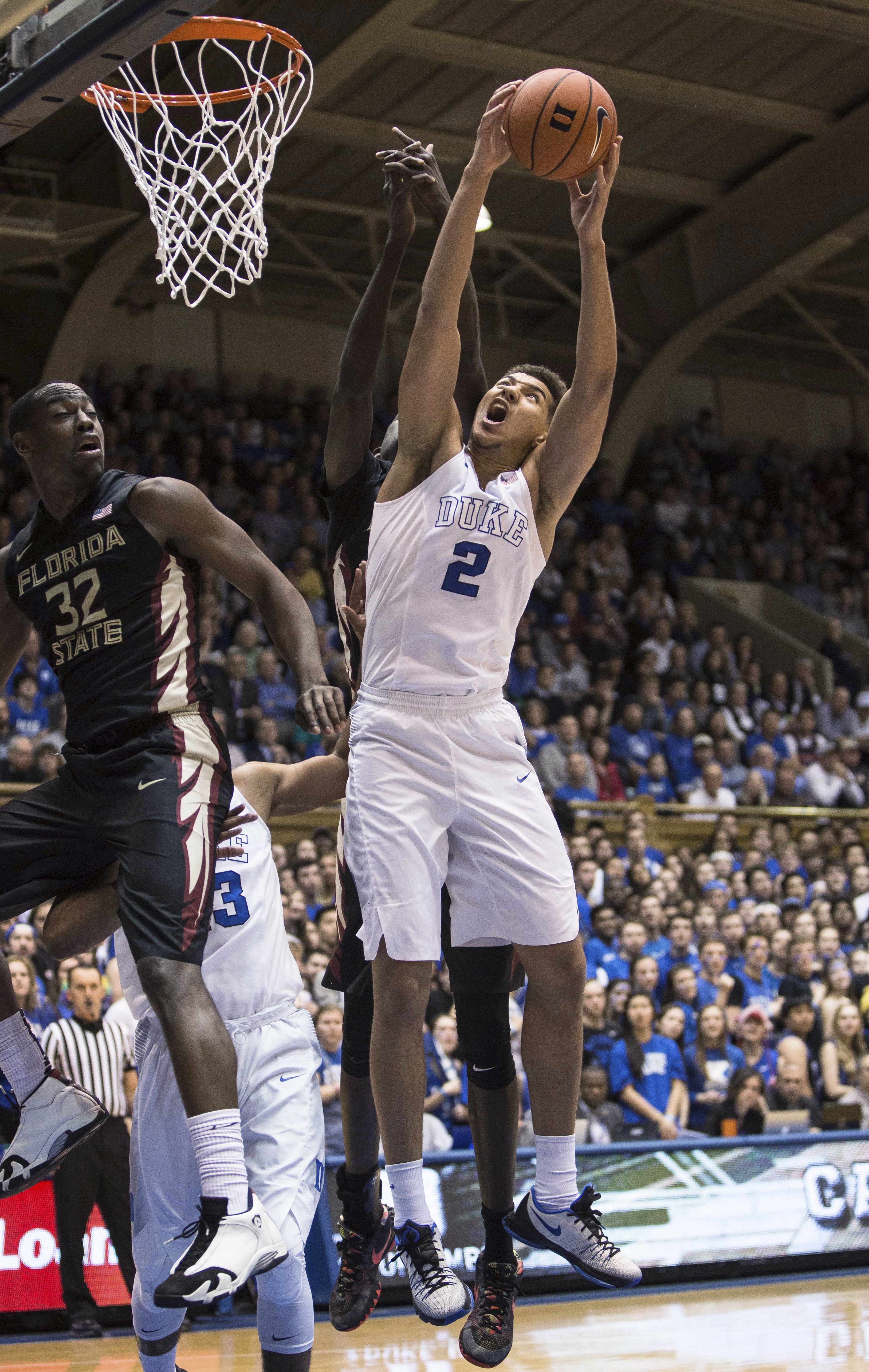 Duke's Chase Jeter (2) goes up for a rebound against Florida State's Montay Brandon (32) during the first half of an NCAA college basketball game in Durham, N.C., Thursday, Feb. 25, 2016. (AP Photo/Ben McKeown)
