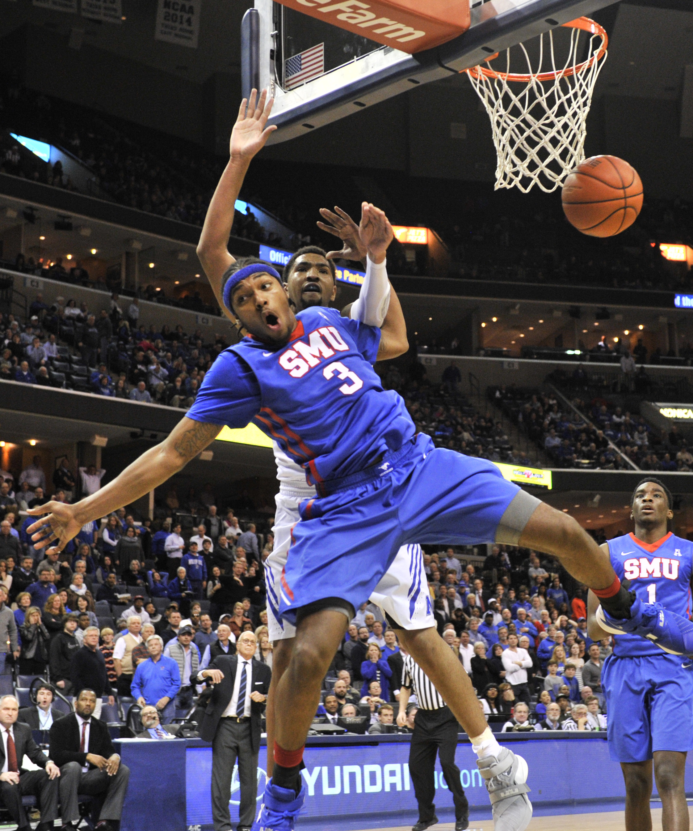 SMU guard Sterling Brown (3) is fouled by Memphis forward Dedric Lawson in the second half of an NCAA college basketball game Thursday, Feb. 25, 2016, in Memphis, Tenn. (AP Photo/Brandon Dill)