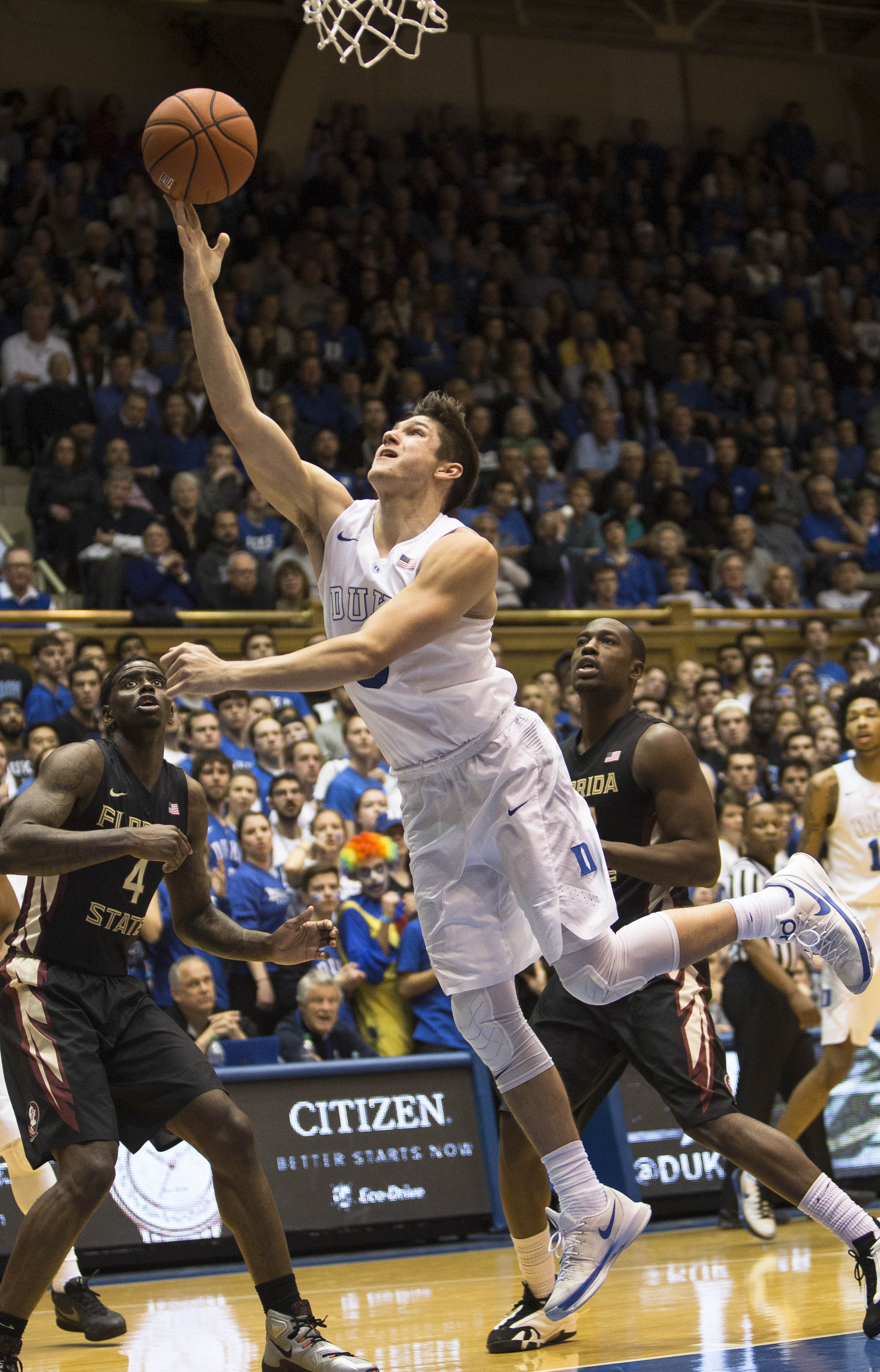 Duke's Grayson Allen attempts a layup as Florida State's Dwayne Bacon (4) and Florida State's Montay Brandon, right, watch during the second half of an NCAA college basketball game in Durham, N.C., Thursday, Feb. 25, 2016. Duke defeated Florida State 80-6