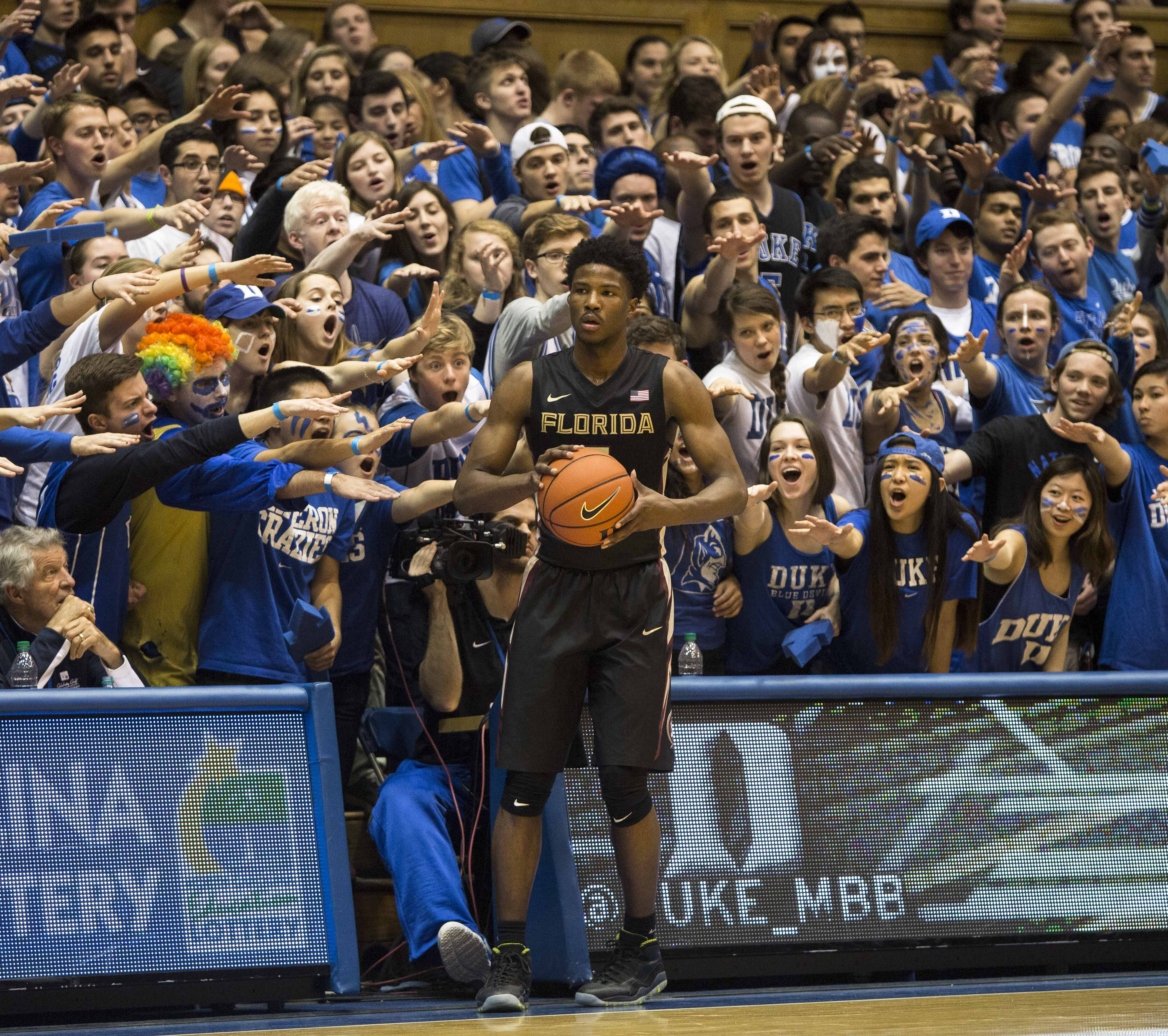 Florida State's Malik Beasley looks to throw in the ball as the Cameron Crazies shout in the background during the team's NCAA college basketball game against Duke in Durham, N.C., Thursday, Feb. 25, 2016. Duke defeated Florida State 80-65. (AP Photo/Ben