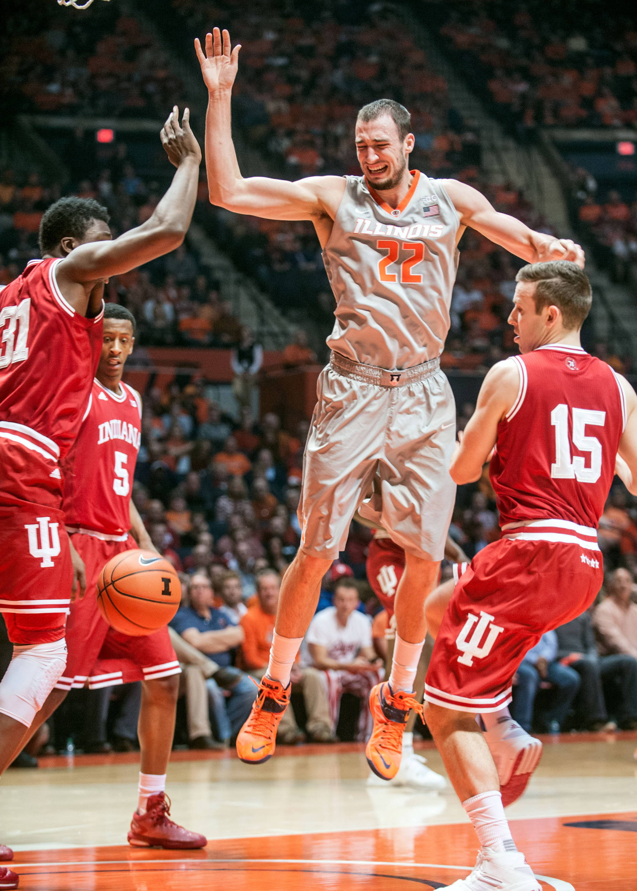 Illinois center Maverick Morgan (22) loses control of the ball after Indiana guard Harrison Niego (15) swatted it from Morgan's grip, as Indiana center Thomas Bryant (31) and Iforward Troy Williams (5) watch during an NCAA college basketball game in Champ
