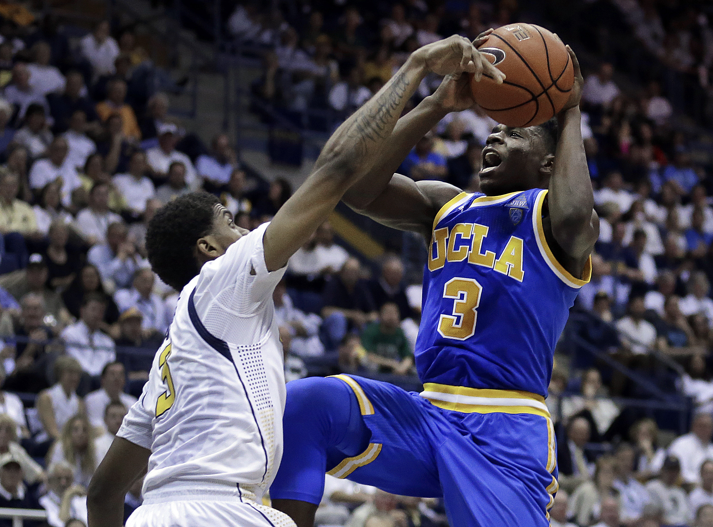 UCLA's Aaron Holiday, right, shoots over California's Tyrone Wallace during the second half of an NCAA college basketball game Thursday, Feb. 25, 2016, in Berkeley, Calif. (AP Photo/Ben Margot)