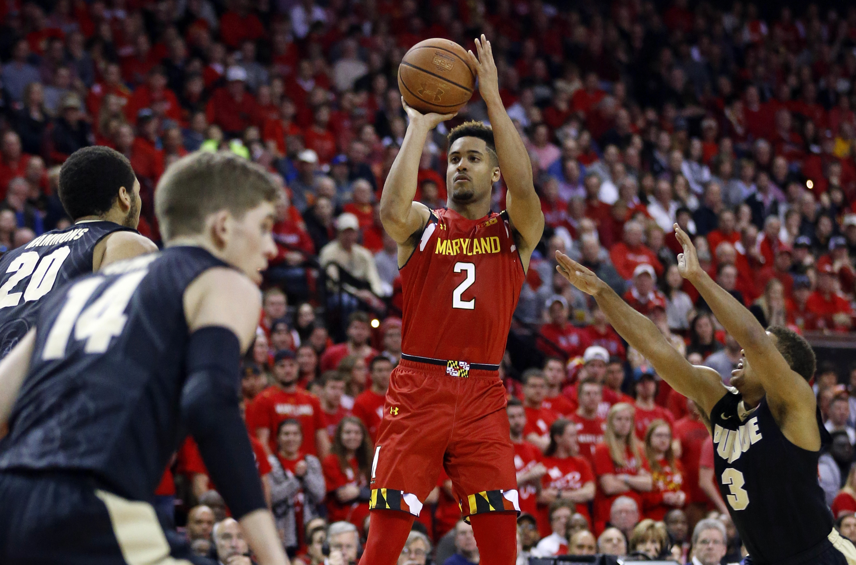 FILE - In this Feb. 6, 2015, file photo, Maryland guard Melo Trimble, center, shoots over Purdue center A.J. Hammons (20), guard Ryan Cline (14) and guard P.J. Thompson in the second half of an NCAA college basketball game, in College Park, Md. Tenth-rank