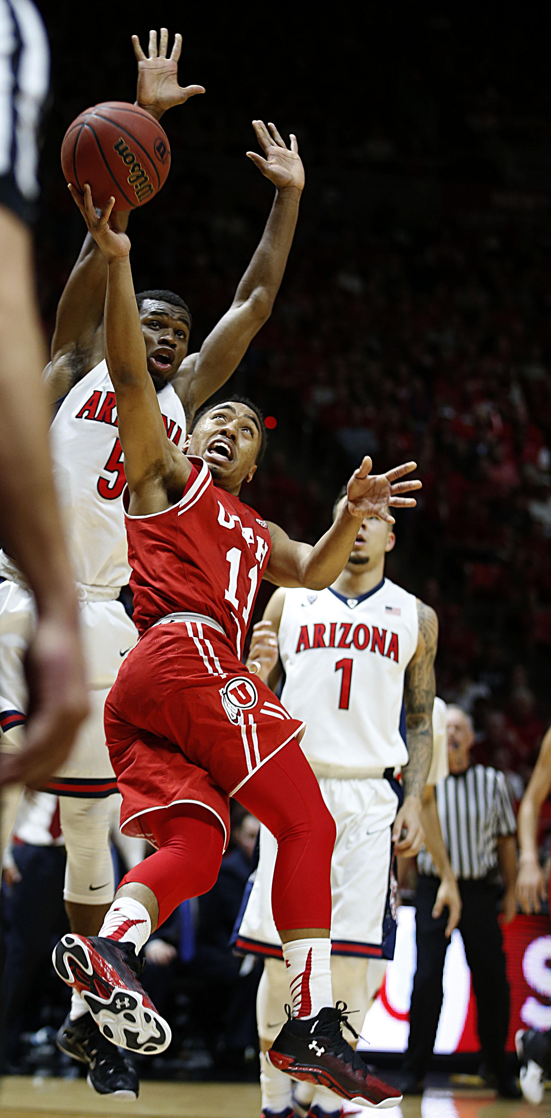 Utah guard Brandon Taylor (11) shoots past Arizona guard Kadeem Allen (5) during the first half of an NCAA college basketball game in Salt Lake City, Saturday, Feb. 27, 2016. (AP Photo/George Frey)