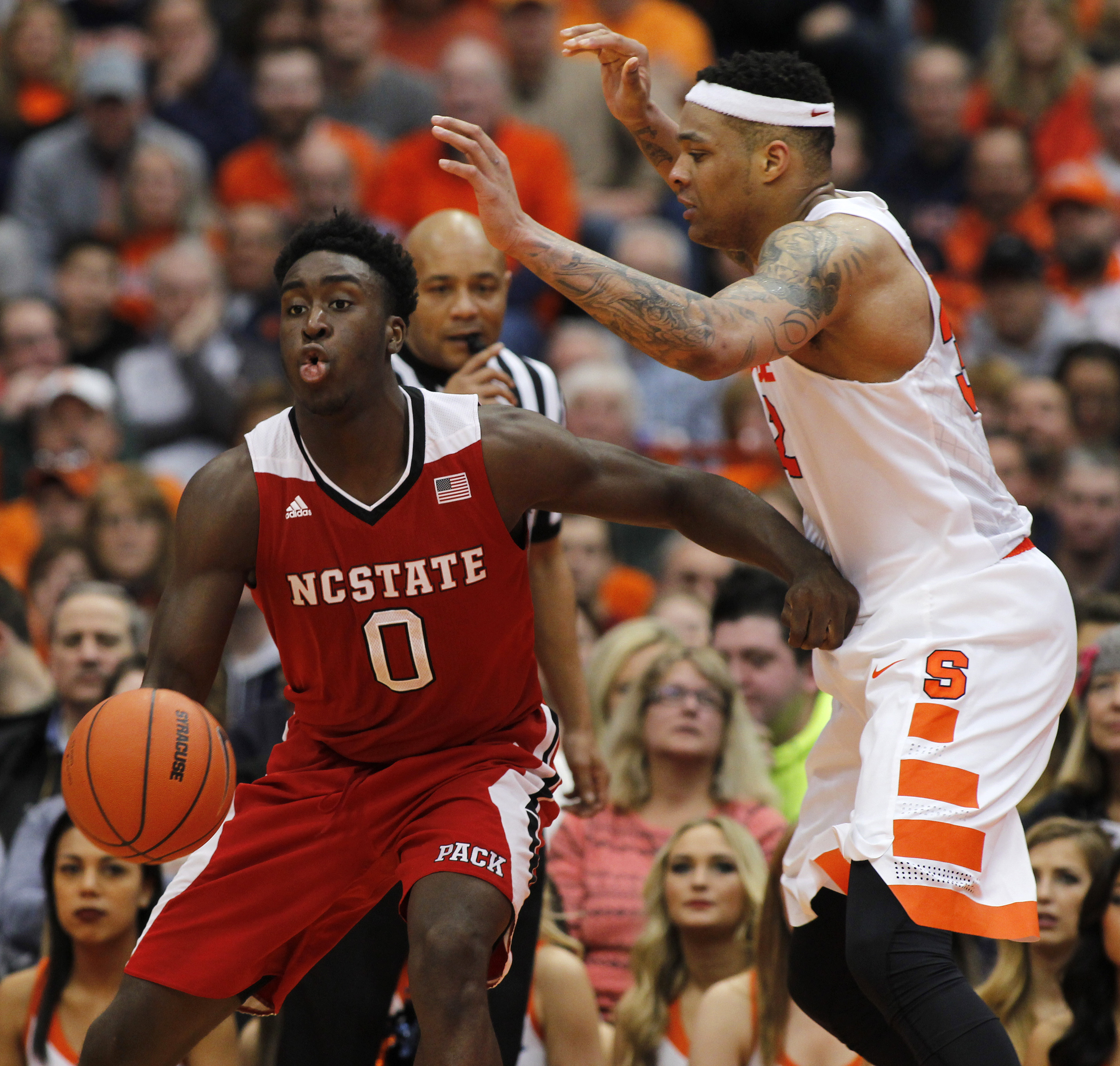 North Carolina State's Abdul Malik-Abu, left, dives to the basket against Syracuse's Dajuan Coleman in the second half of an NCAA college basketball game in Syracuse, N.Y., Saturday, Feb. 27, 2016. Syracuse won 75-66. (AP Photo/Nick Lisi)