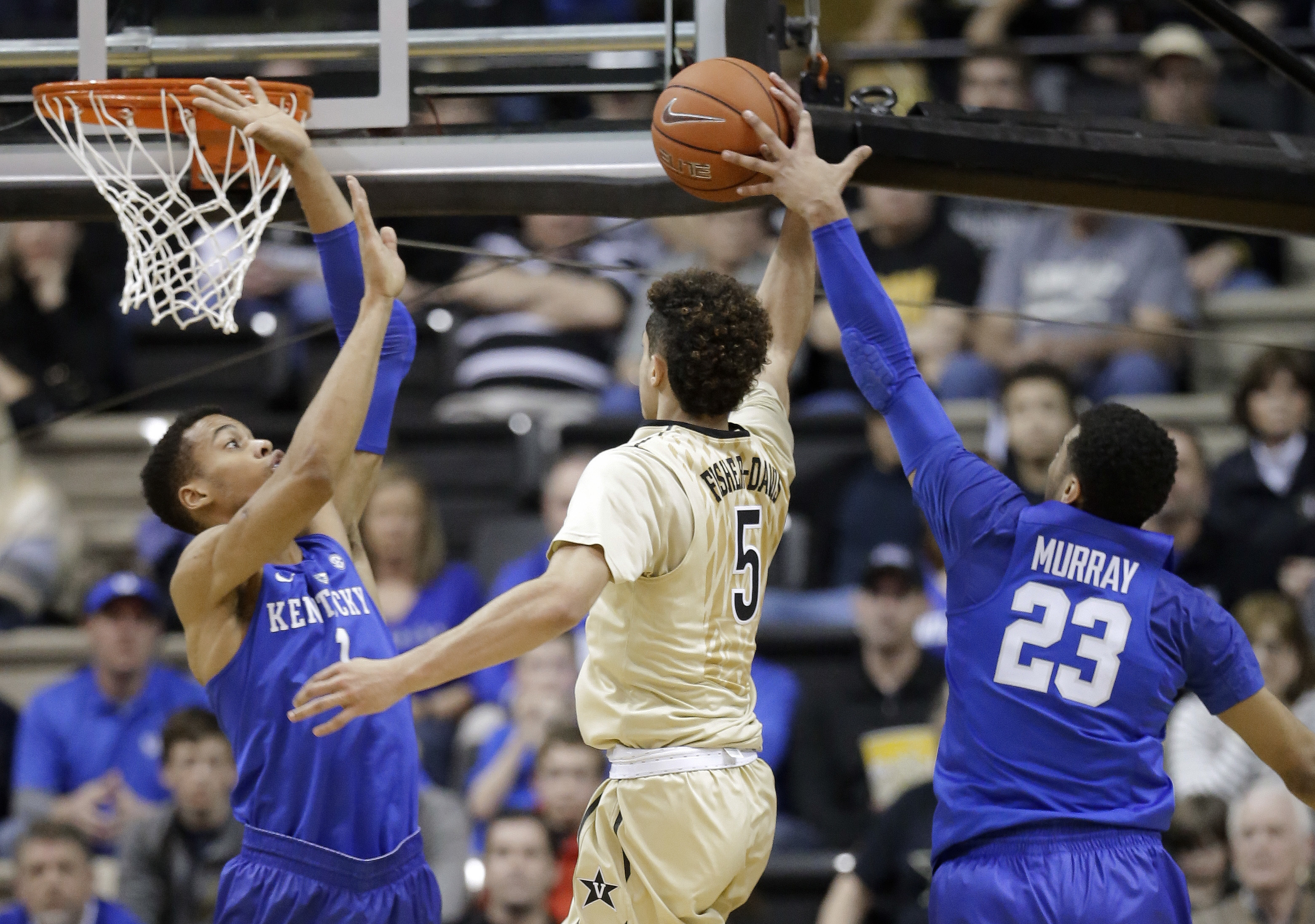 Vanderbilt guard Matthew Fisher-Davis (5) drives between Kentucky's Skal Labissiere (1) and Jamal Murray (23) in the first half of an NCAA college basketball game Saturday, Feb. 27, 2016, in Nashville, Tenn. (AP Photo/Mark Humphrey)