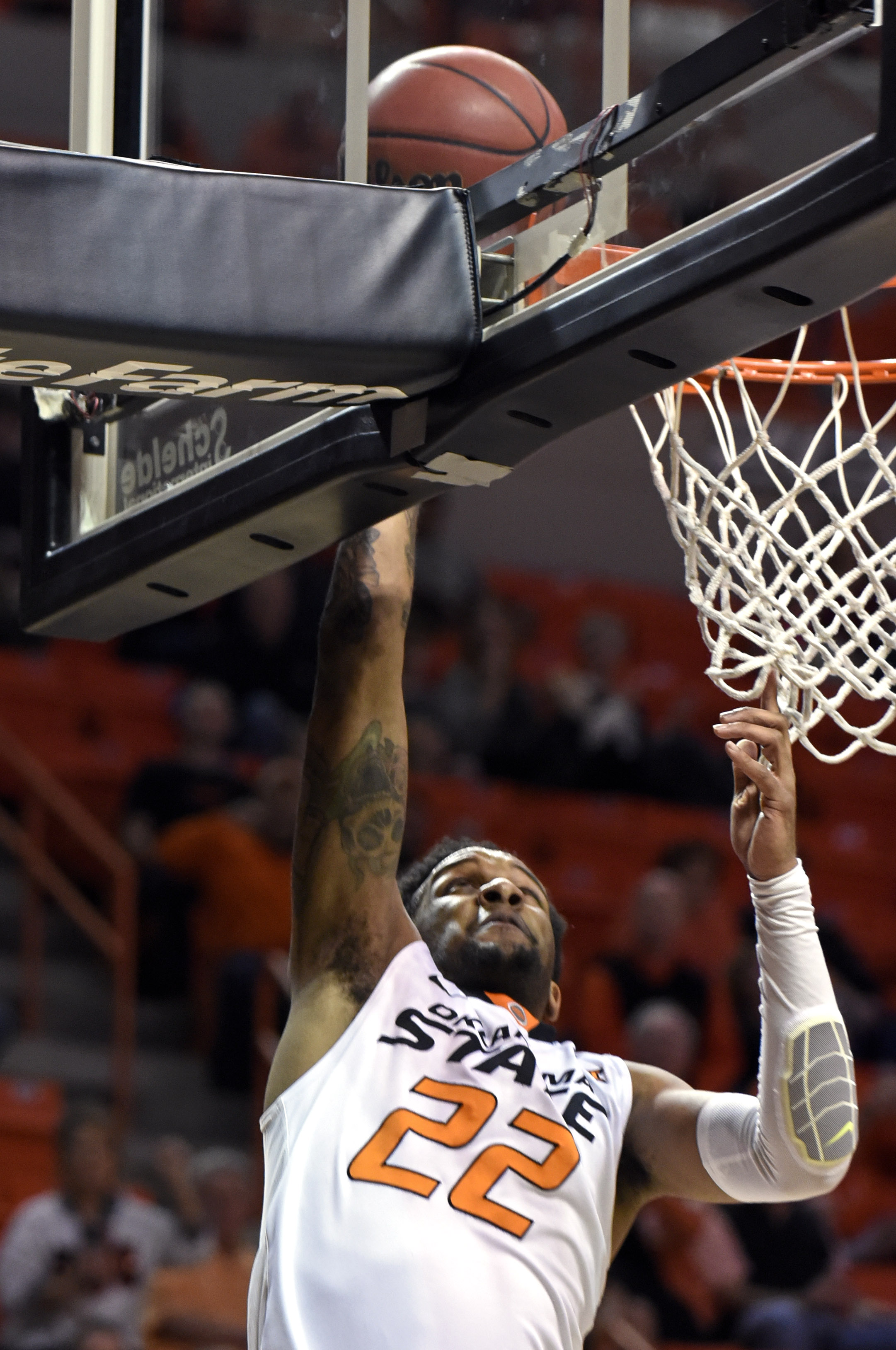 Oklahoma State guard Jeff Newberry makes a basket in the first half of an NCAA college basketball game against West Virginia in Stillwater, Okla., Saturday, Feb. 27, 2016. (AP Photo/Brody Schmidt)
