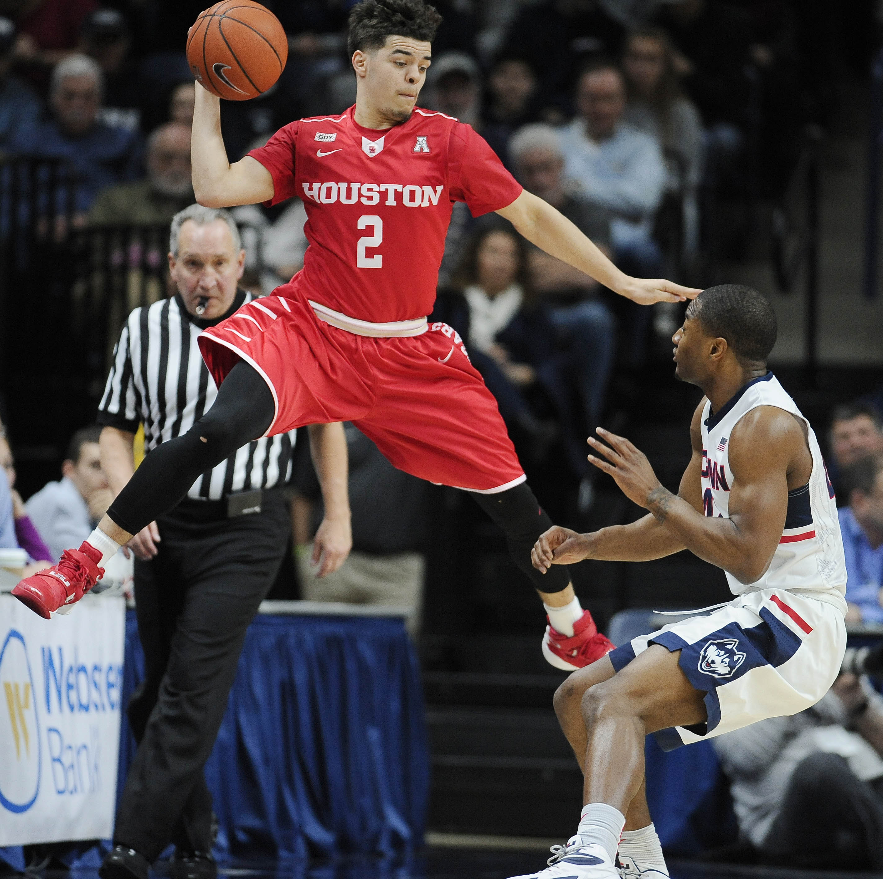 Houston's Rob Gray, Jr., left, looks to pass around Connecticut's Rodney Purvis, right, in the first half of an NCAA college basketball game, Sunday, Feb. 28, 2016, in Storrs, Conn. (AP Photo/Jessica Hill)