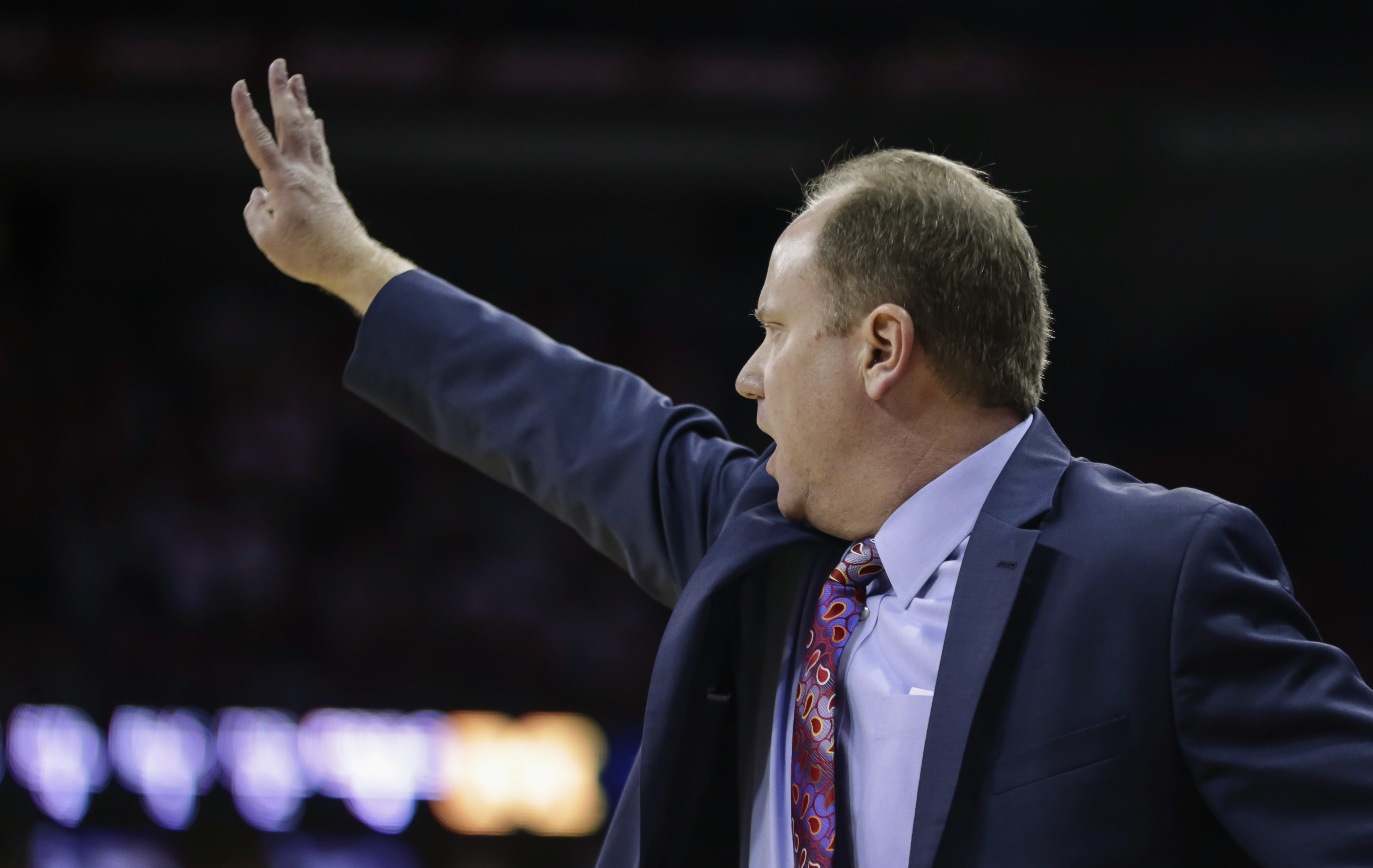 Wisconsin interim head coach Greg Gard signals to his team during the second half of an NCAA college basketball game against Michigan on Sunday, Feb. 28, 2016, in Madison, Wis. Wisconsin won 68-57. (AP Photo/Andy Manis)