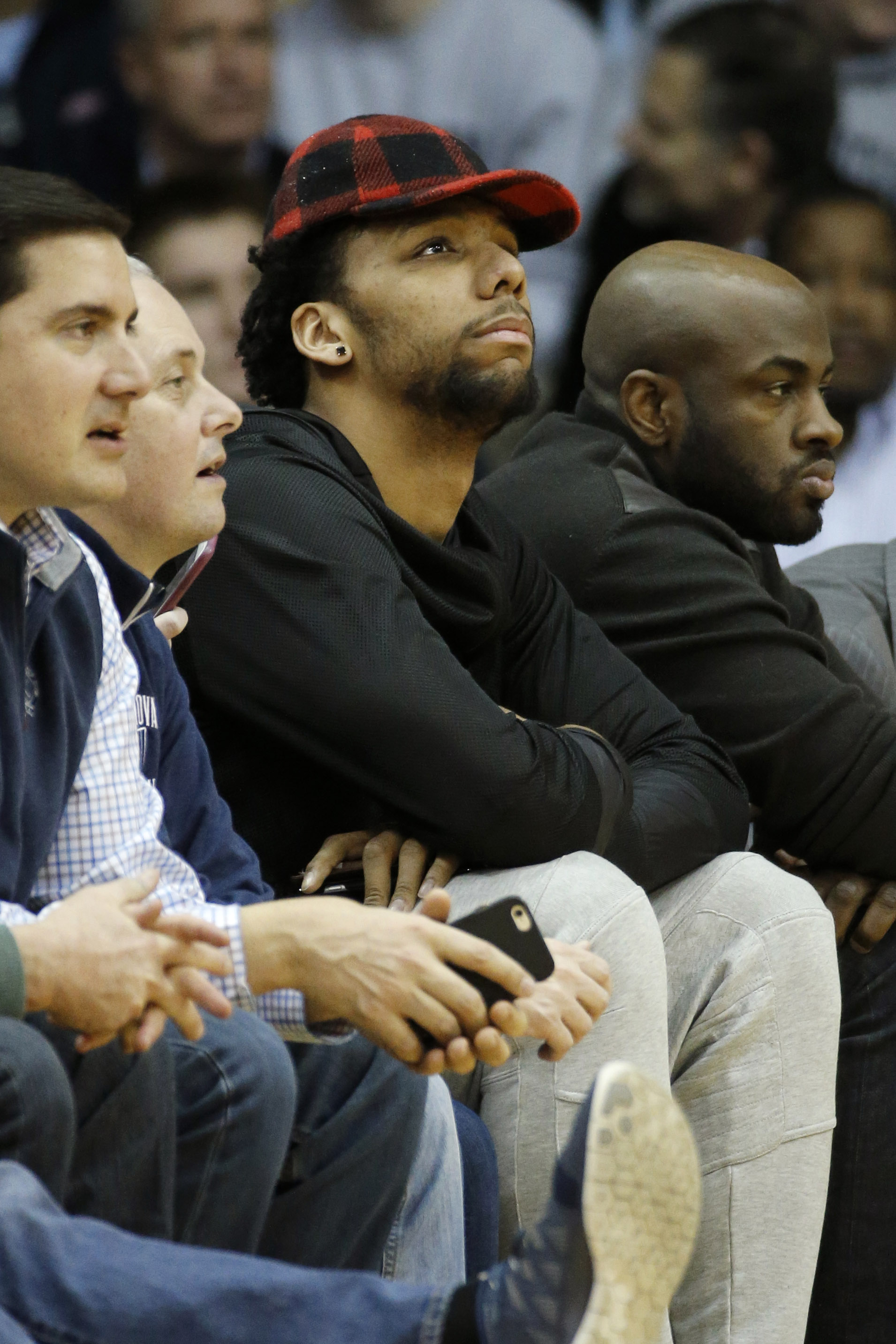 Philadelphia 76ers' Jahlil Okafor watches the first half of an NCAA college basketball game between Villanova and DePaul, Tuesday, March 1, 2016, in Philadelphia. (AP Photo/Matt Slocum)
