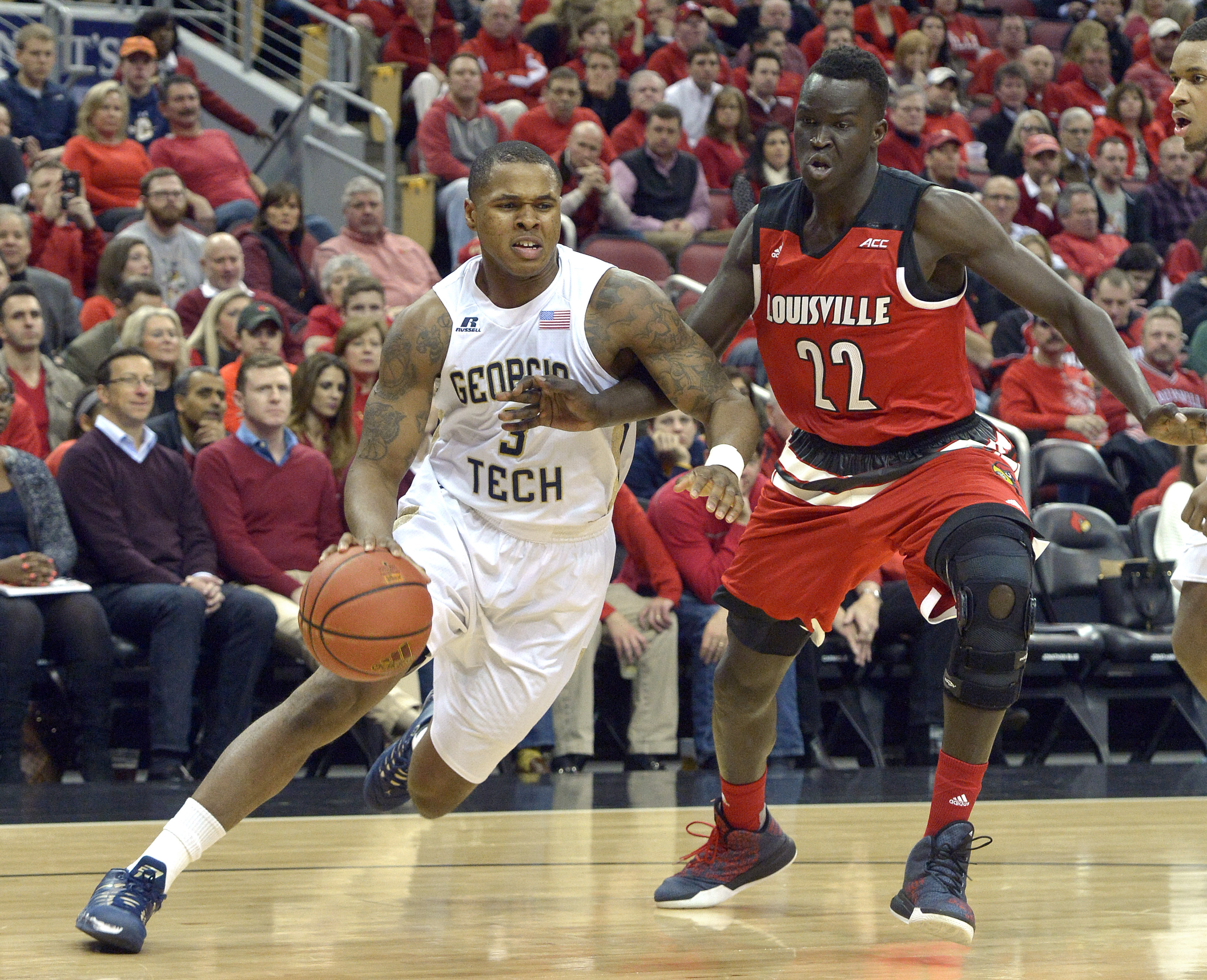 Georgia Tech's Marcus Georges-Hunt (3) attempts to drive around Louisville's Deng Adel (22) during the first half of an NCAA college basketball game, Tuesday, March 1, 2016 in Louisville Ky. (AP Photo/Timothy D. Easley)