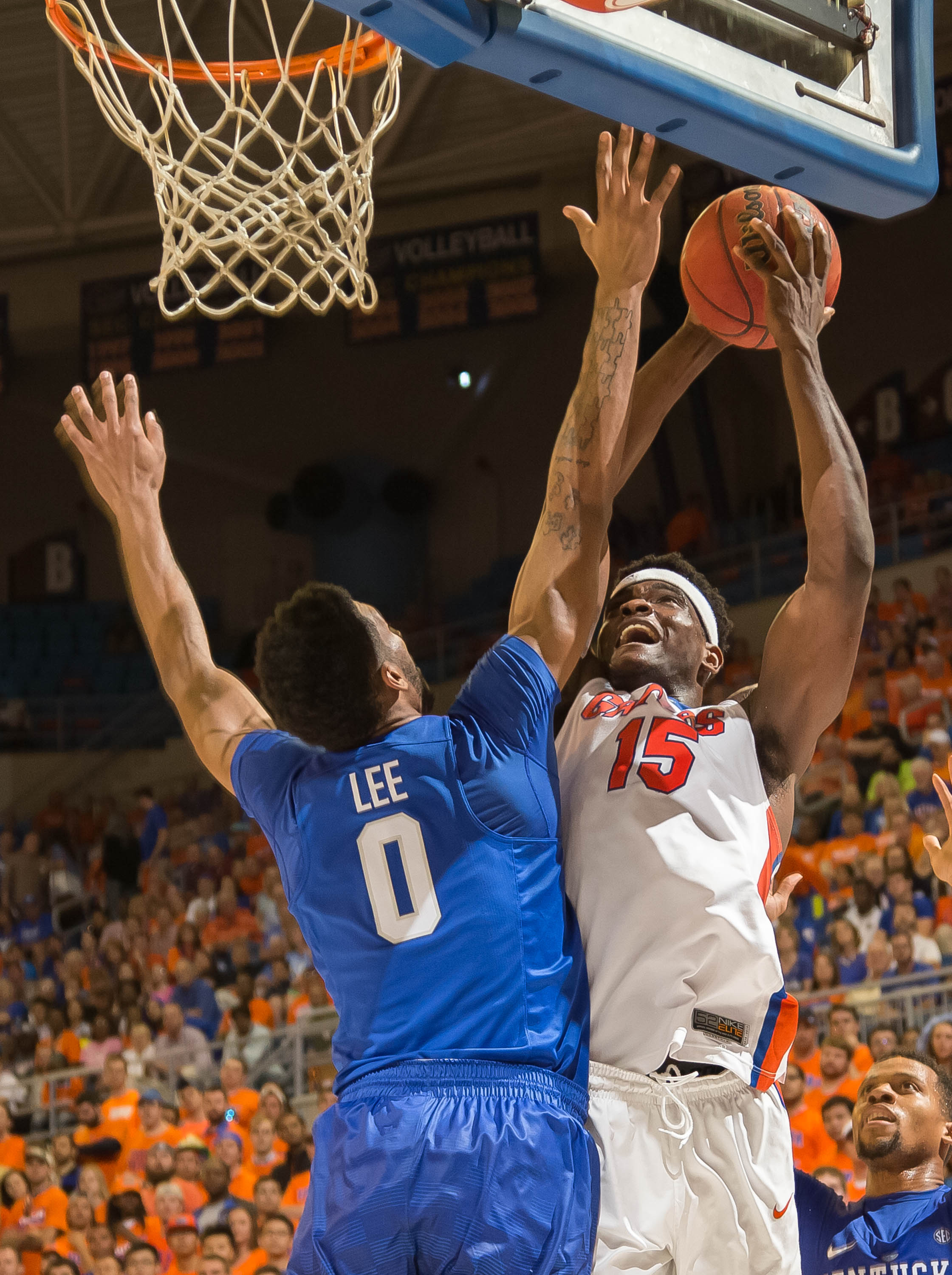 Florida center John Egbunu (15) shots a short jumper over Kentucky forward Marcus Lee (00) during the second half of an NCAA college basketball game in Gainesville, Fla., on Tuesday, March 1, 2016. Kentucky won 88-79. (AP Photo/Ronald Irby)