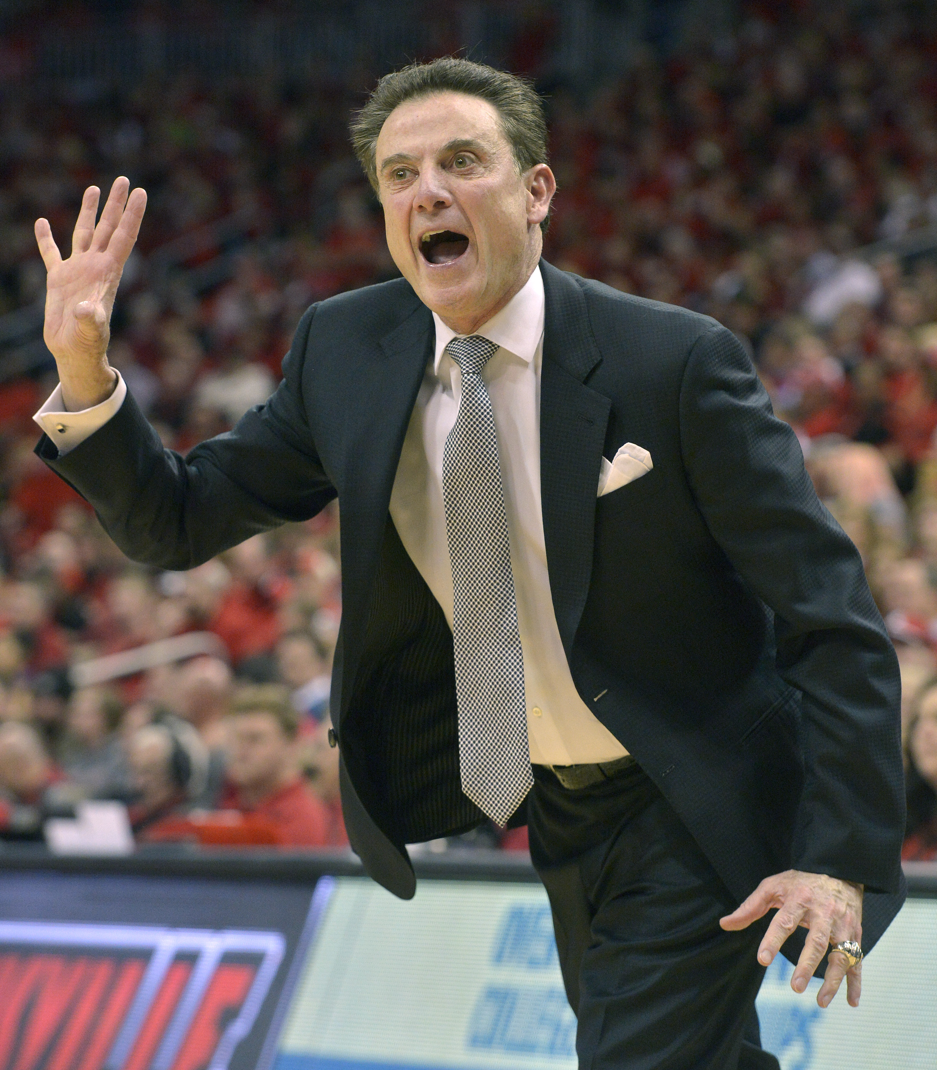 Louisville's head coach Rick Pitino shouts instructions to his team during the first half of an NCAA college basketball game against Georgia Tech, Tuesday, March 1, 2016 in Louisville Ky. Louisville won 56-53. (AP Photo/Timothy D. Easley)