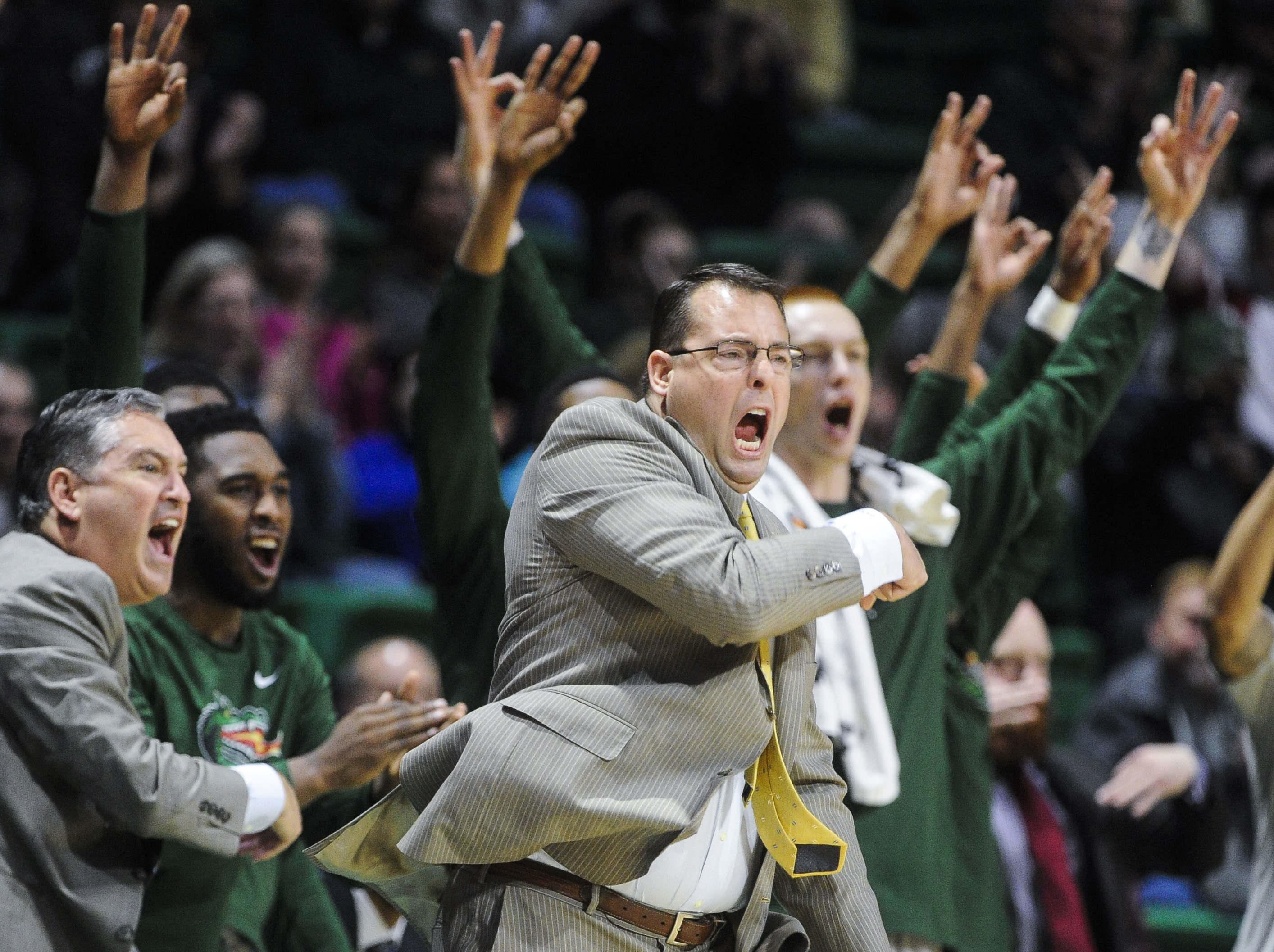 FILE - In this Jan. 9, 2016, file photo, UAB head coach Jerod Haase celebrates a basket along with his bench during the first half of an NCAA college basketball game against UTEP  in Birmingham, Ala. The Blazers have one of the best records in major colle