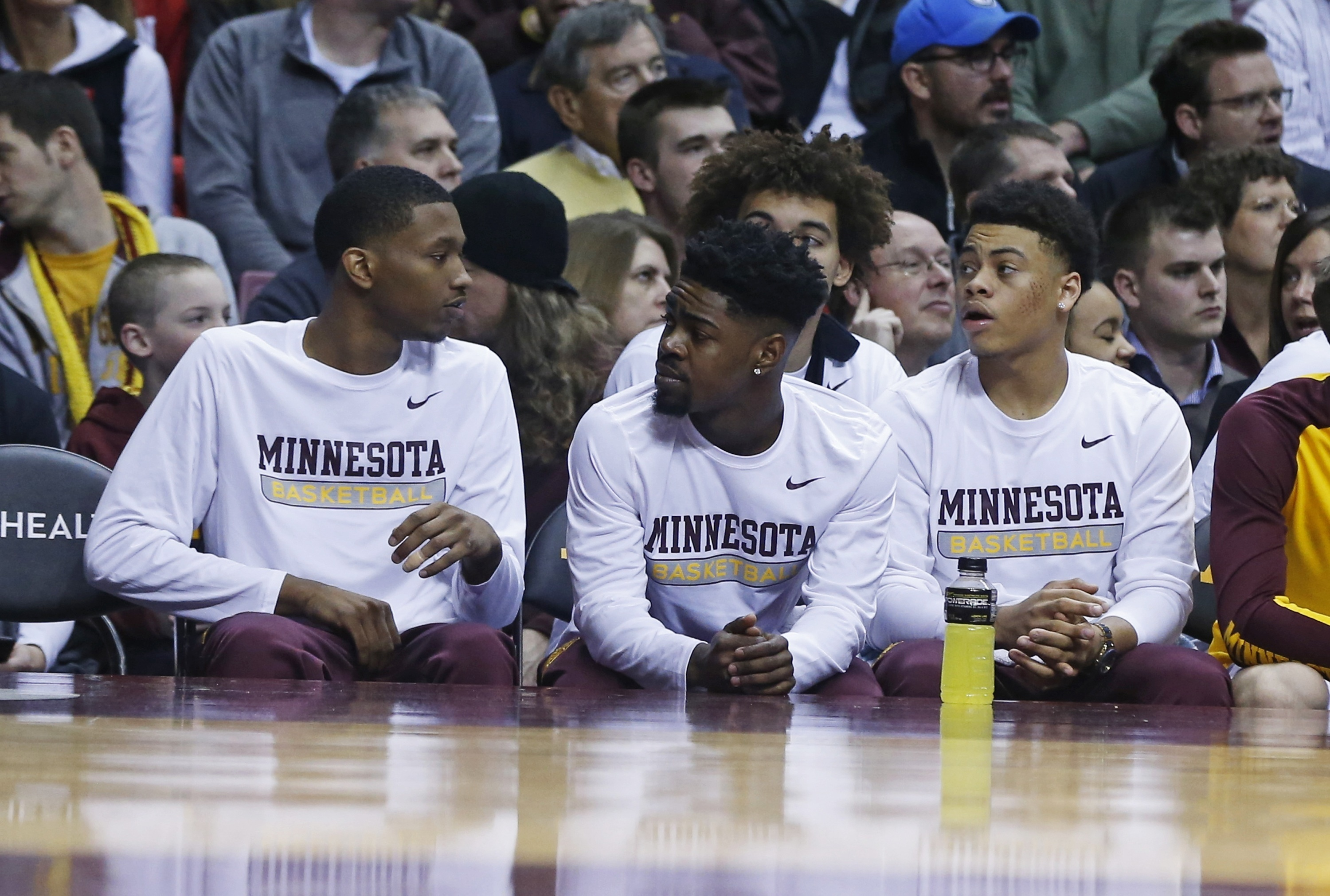 Minnesota's Dupree McBrayer, left, Kevin Dorsey, Jr., center and Nate Mason, right, are benched during an NCAA college basketball game Wednesday, March 2, 2016, in Minneapolis. Coach Richard Pitino announced Tuesday that the three will be suspended for th