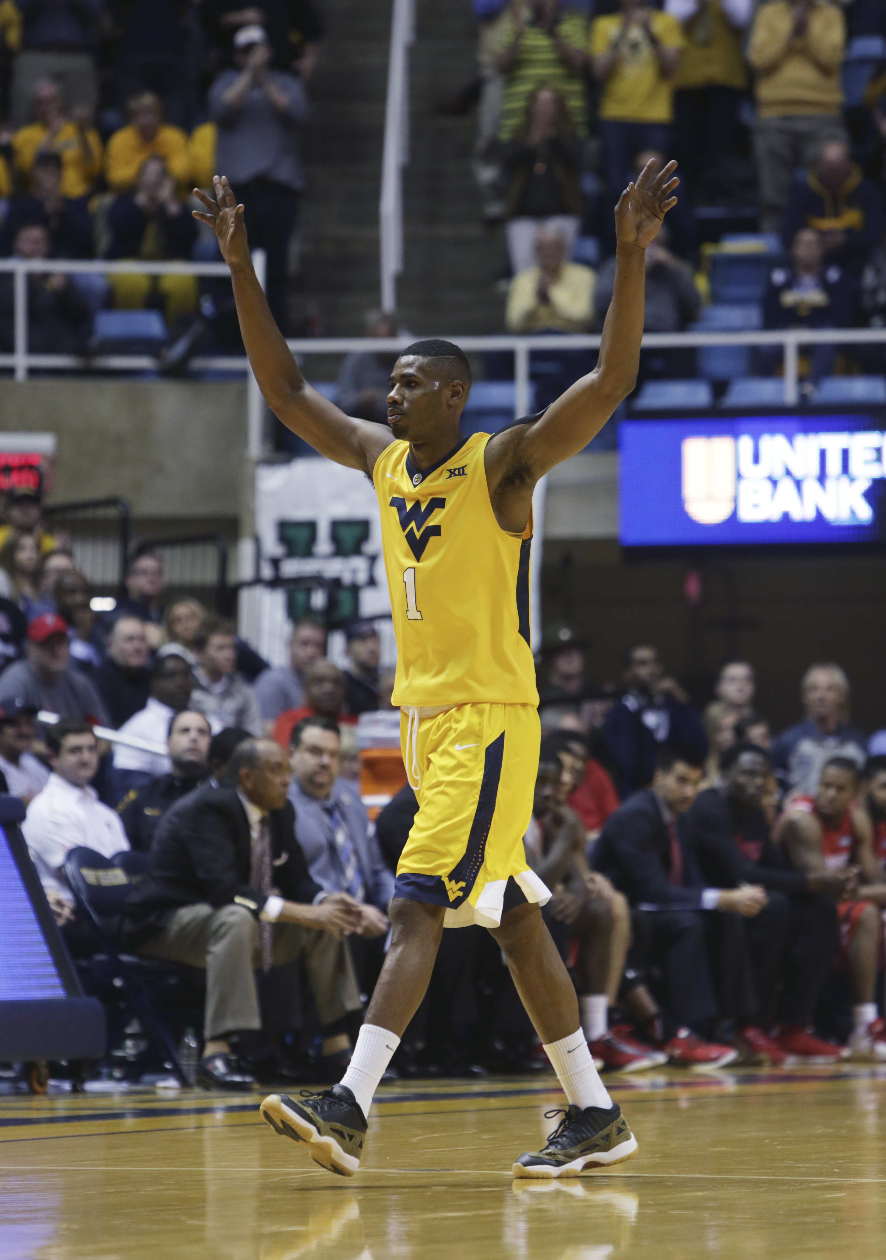 West Virginia forward Jonathan Holton waves goodbye to the fans as he walks to the bench during the second half of the team's NCAA college basketball game against Texas Tech, Wednesday, March, 2, 2016, in Morgantown, W.Va. West Virginia, in its final home