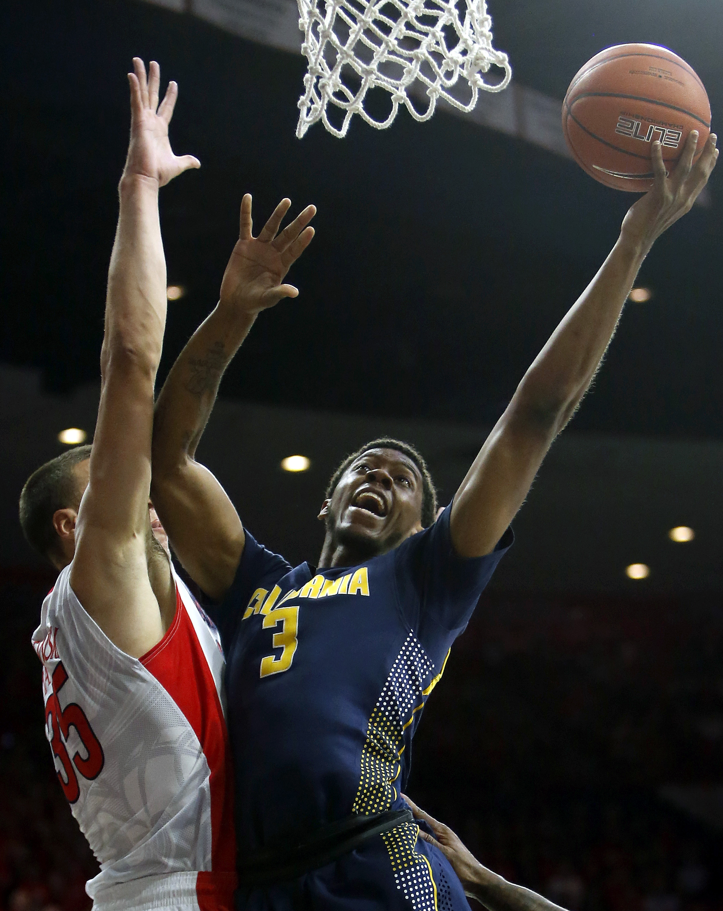 California guard Tyrone Wallace (3) drives against Arizona center Kaleb Tarczewski during the first half of an NCAA college basketball game, Thursday, March 3, 2016, in Tucson, Ariz. (AP Photo/Rick Scuteri)