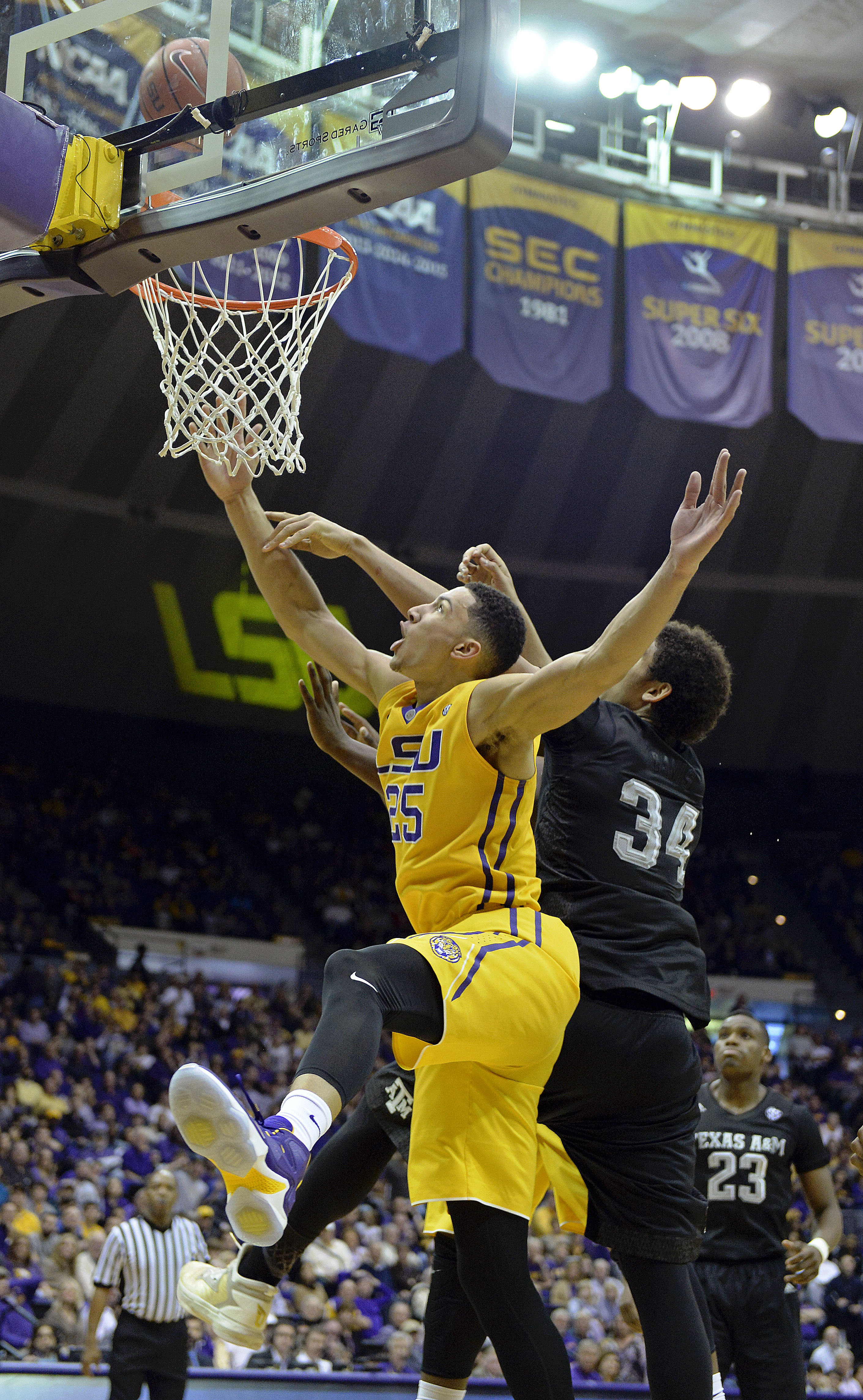 FILE - In this Feb. 13, 2016, file photo, LSU forward Ben Simmons (25) shoots as Texas A&M center Tyler Davis (34) defends iduring the first half of an NCAA college basketball game in Baton Rouge, La. Simmons was a preseason freshman all-American as a pot