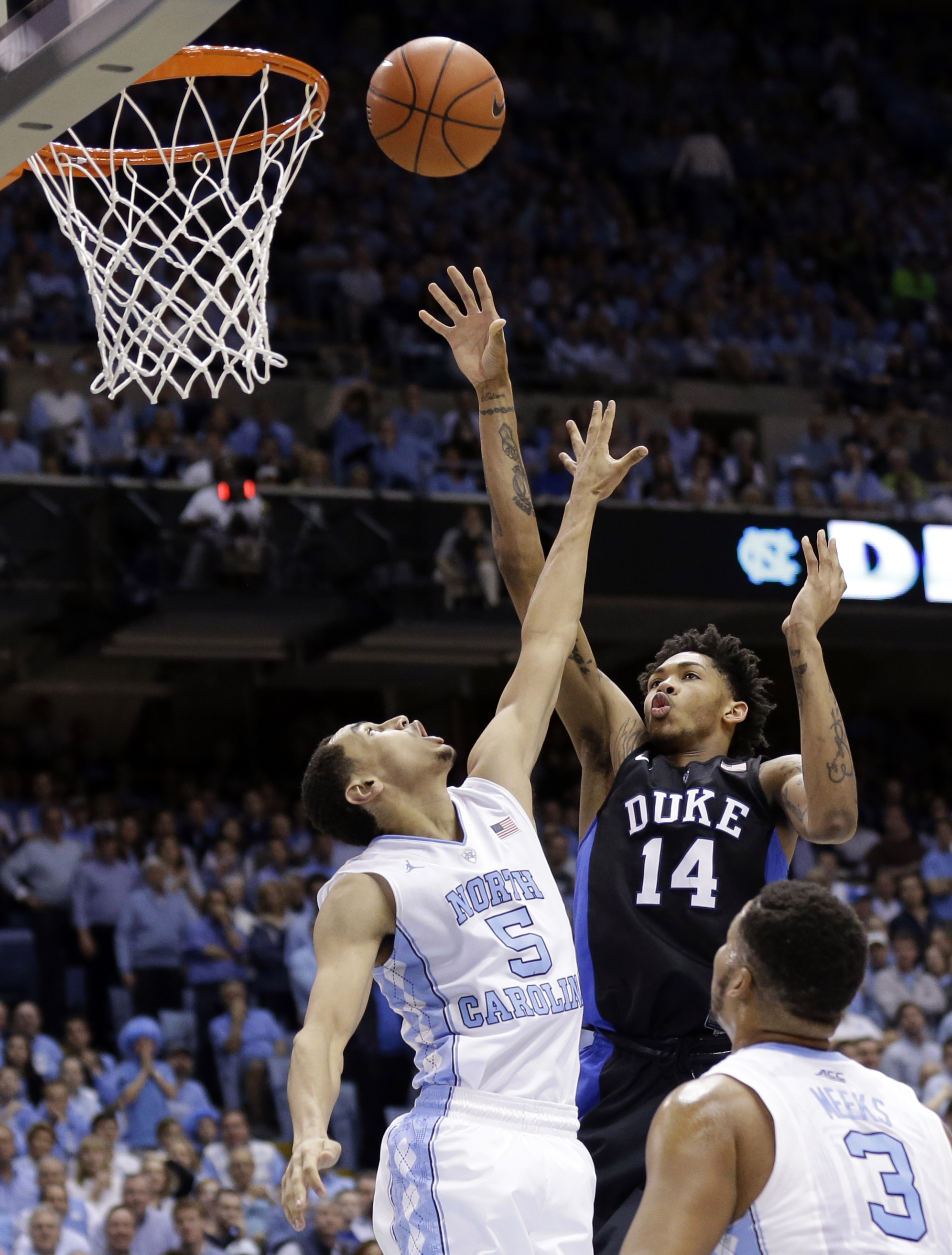 FILE - In this Feb. 17, 2016, file photo, Duke's Brandon Ingram (14) shoots over  North Carolina's Marcus Paige (5)  during the second half of an NCAA college basketball game in Chapel Hill, N.C. Ingram has a knack for foiling North Carolina. The instate