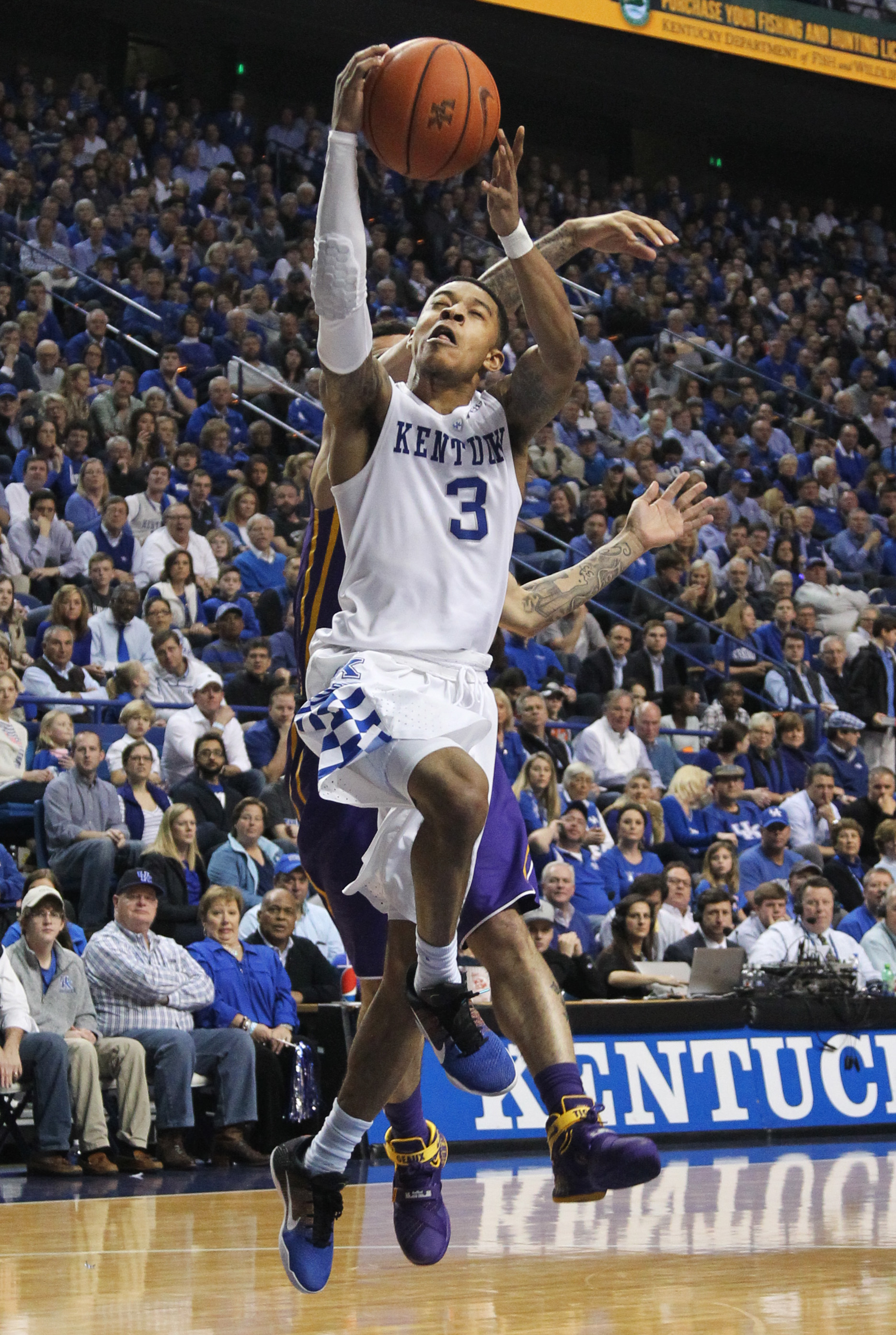 Kentucky's Tyler Ulis (3) is fouled by LSU's Josh Gray during the second half of an NCAA college basketball game Saturday, March 5, 2016, in Lexington, Ky. Kentucky won 94-77. (AP Photo/James Crisp)