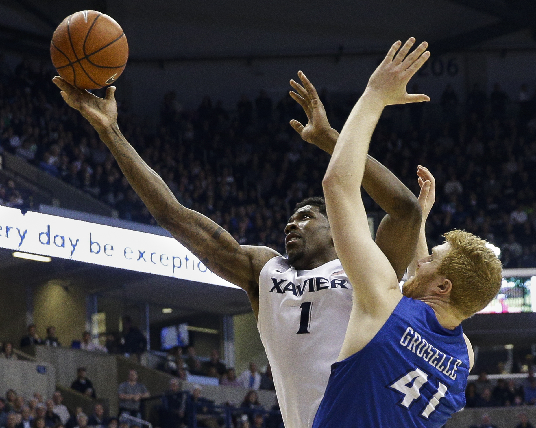 Xavier's Jalen Reynolds (1) shoots against Creighton's Geoffrey Groselle (41) during the first half of an NCAA college basketball game, Saturday, March 5, 2016, in Cincinnati. (AP Photo/John Minchillo)