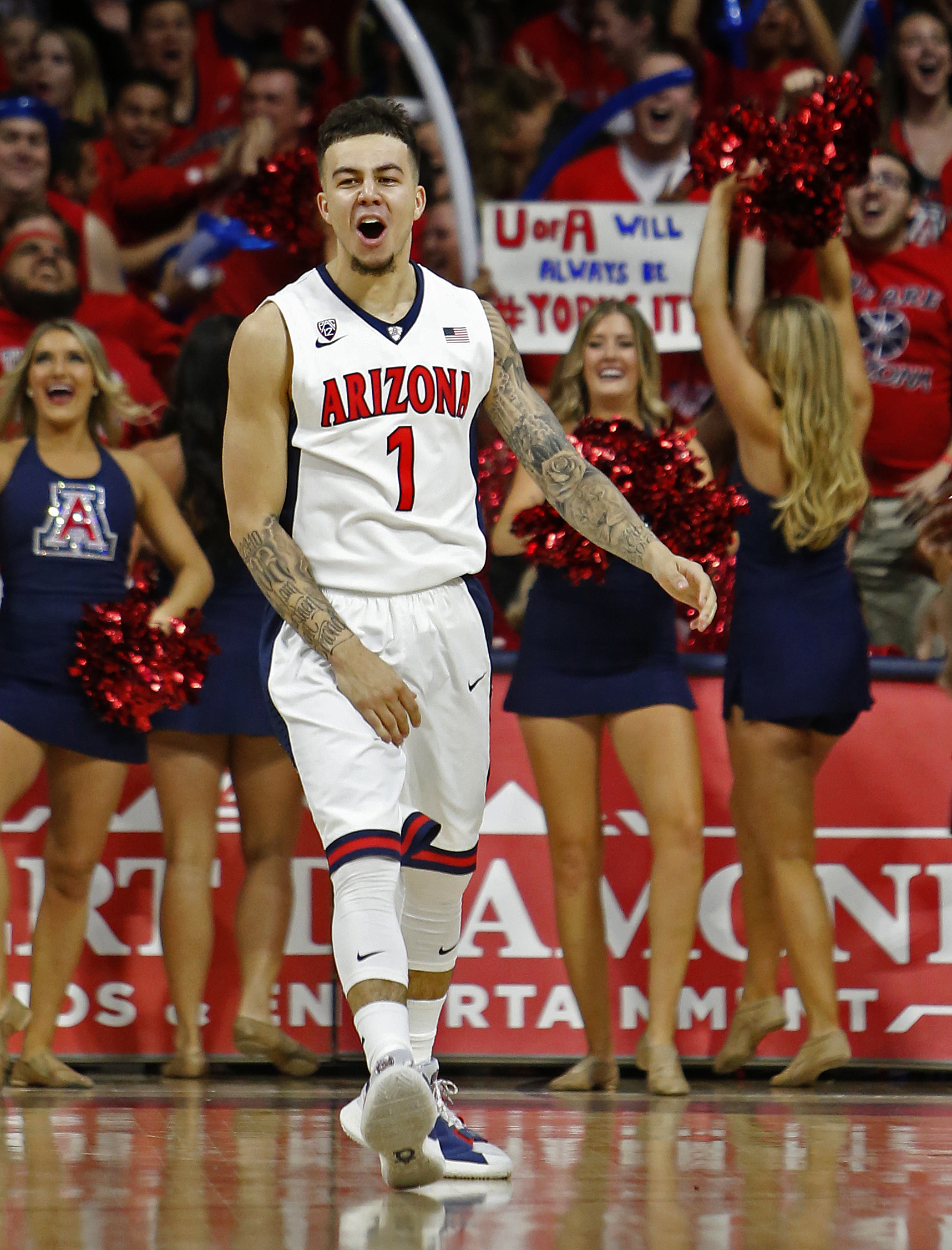 Arizona guard Gabe York (1) celebrates after scoring against Stanford during the second half of an NCAA college basketball game, Saturday, March 5, 2016, in Tucson, Ariz. Arizona defeated Stanford  94-62. (AP Photo/Rick Scuteri)