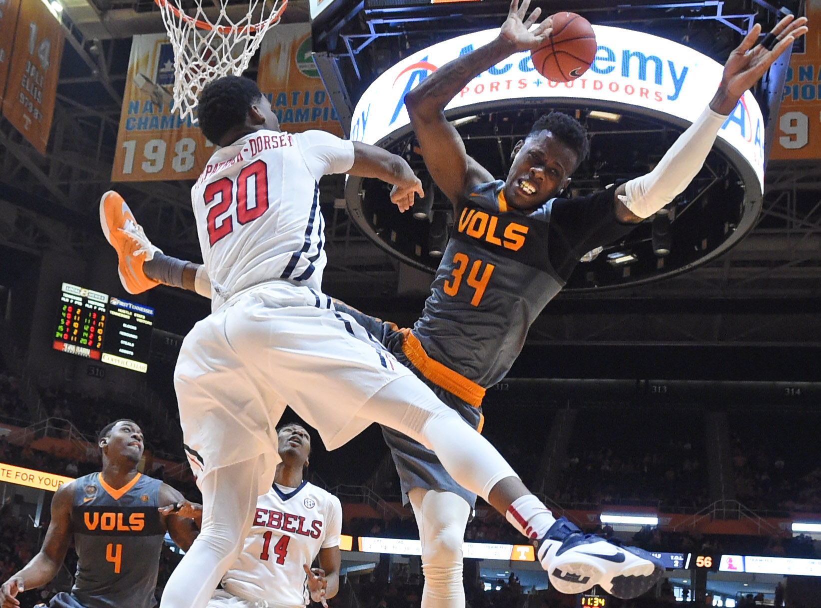 Tennessee guard Devon Baulkman (34) is fouled by Mississippi guard Donte Fitzpatrick-Dorsey (20) while attempting to score during the second half of an NCAA college basketball game, Saturday, March 5, 2016, in Knoxville, Tenn. (Adam Lau/Knoxville News Sen