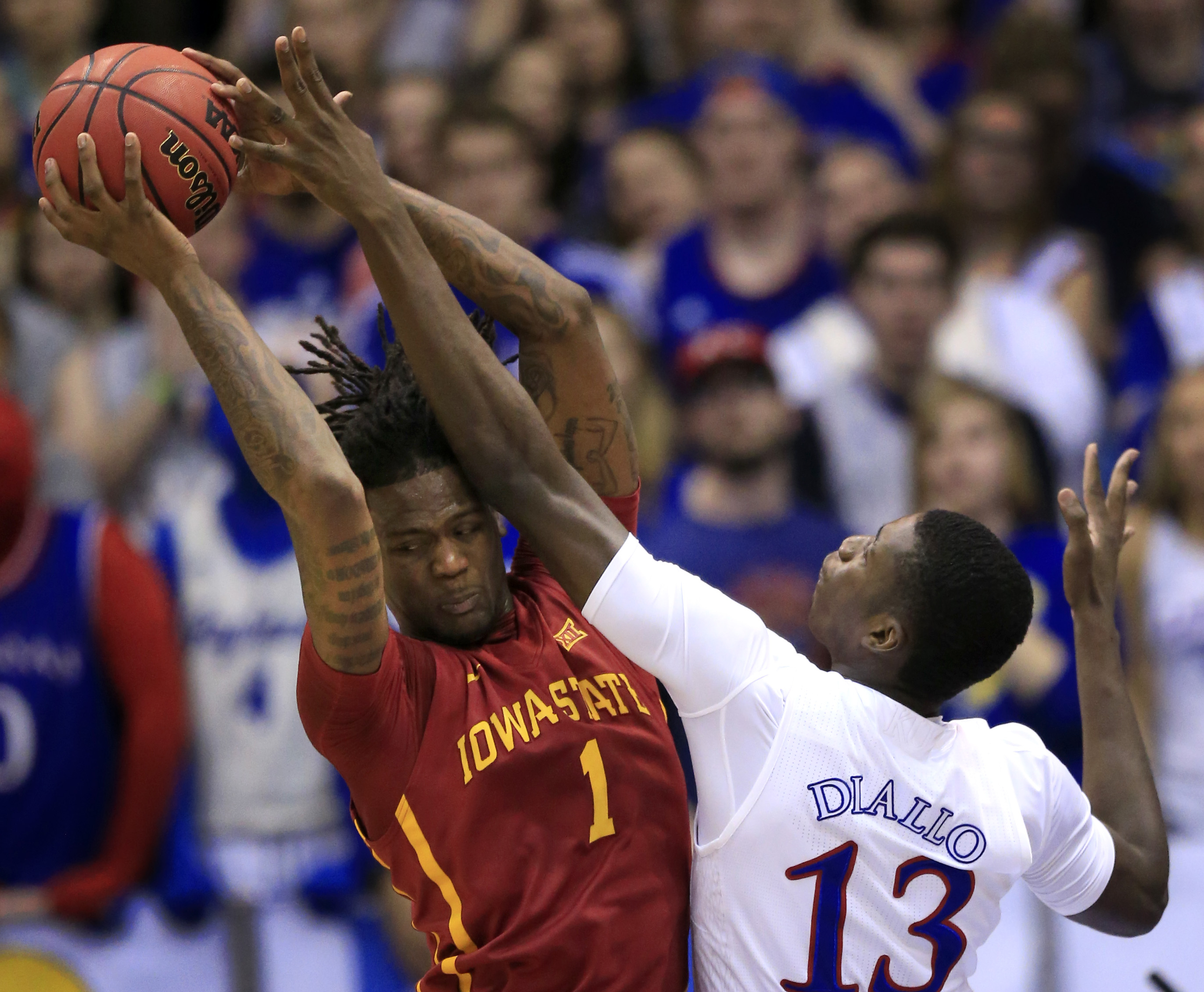 Iowa State forward Jameel McKay (1) rebounds against Kansas forward Cheick Diallo (13) during the first half of an NCAA college basketball game in Lawrence, Kan., Saturday, March 5, 2016. (AP Photo/Orlin Wagner)