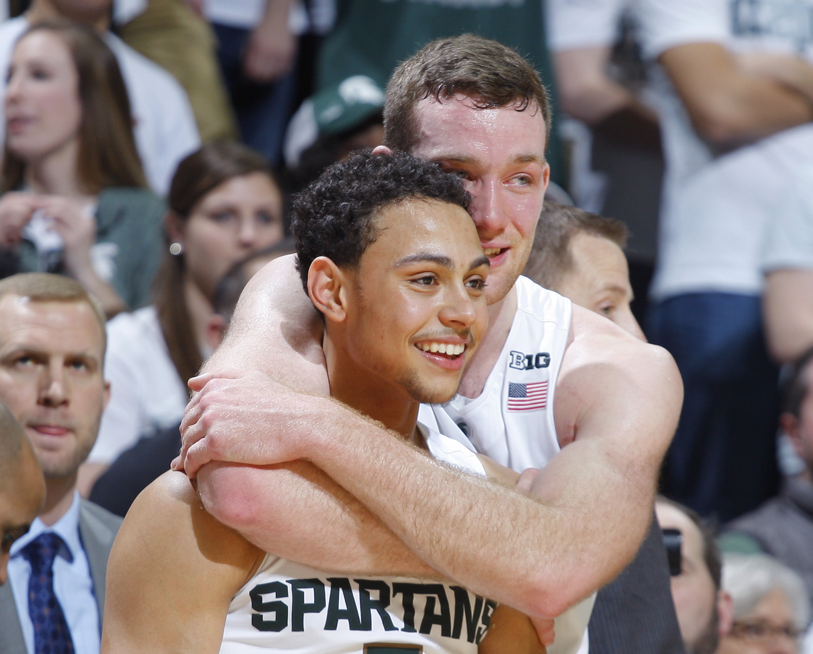 Michigan State seniors Bryn Forbes, left, and Matt Costello watch from the bench during the closing moments of an NCAA college basketball game against Ohio State, Saturday, March 5, 2016, in East Lansing, Mich. Michigan State won 91-76. (AP Photo/Al Goldi