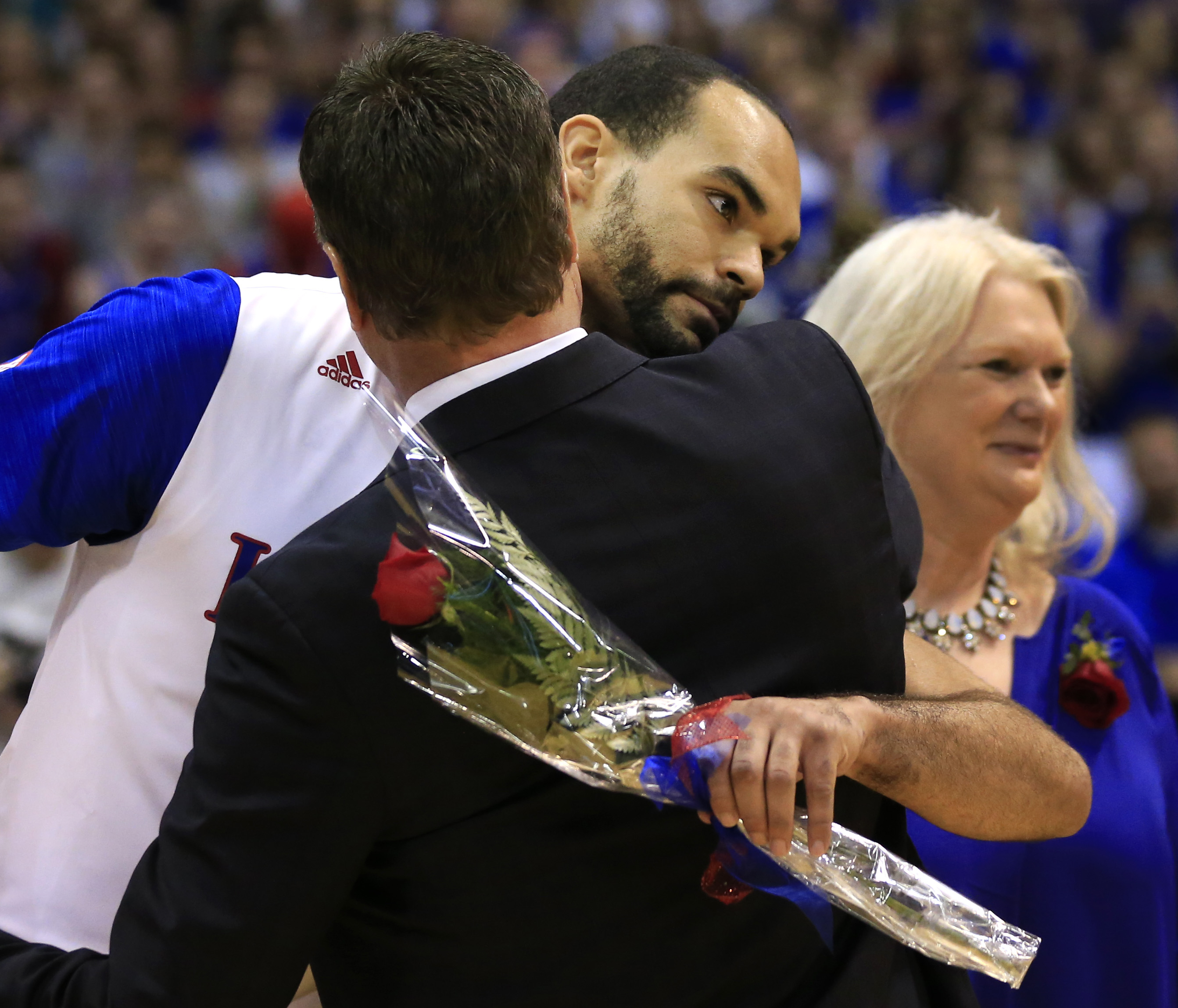 Kansas senior Perry Ellis hugs head coach Bill Self before starting his last regular season NCAA college basketball game in Allen Fieldhouse in Lawrence, Kan., Saturday, March 5, 2016. (AP Photo/Orlin Wagner)