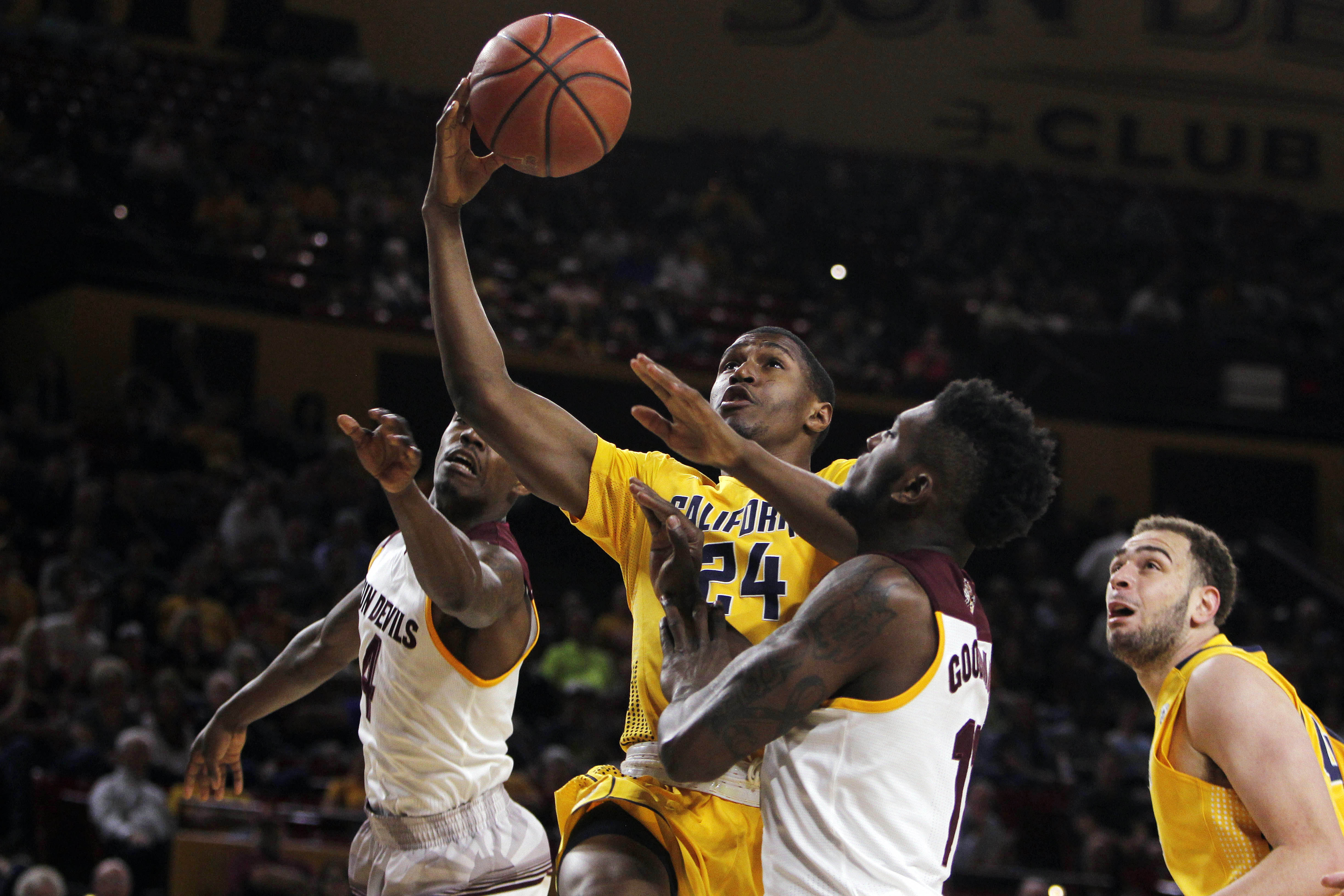 California guard Jordan Mathews (24) goes up to the basket against Arizona State guard Gerry Blakes, left, and Savon Goodman during the first half of an NCAA college basketball game in Tempe, Ariz., Saturday, March 5, 2016. (AP Photo/Ricardo Arduengo)