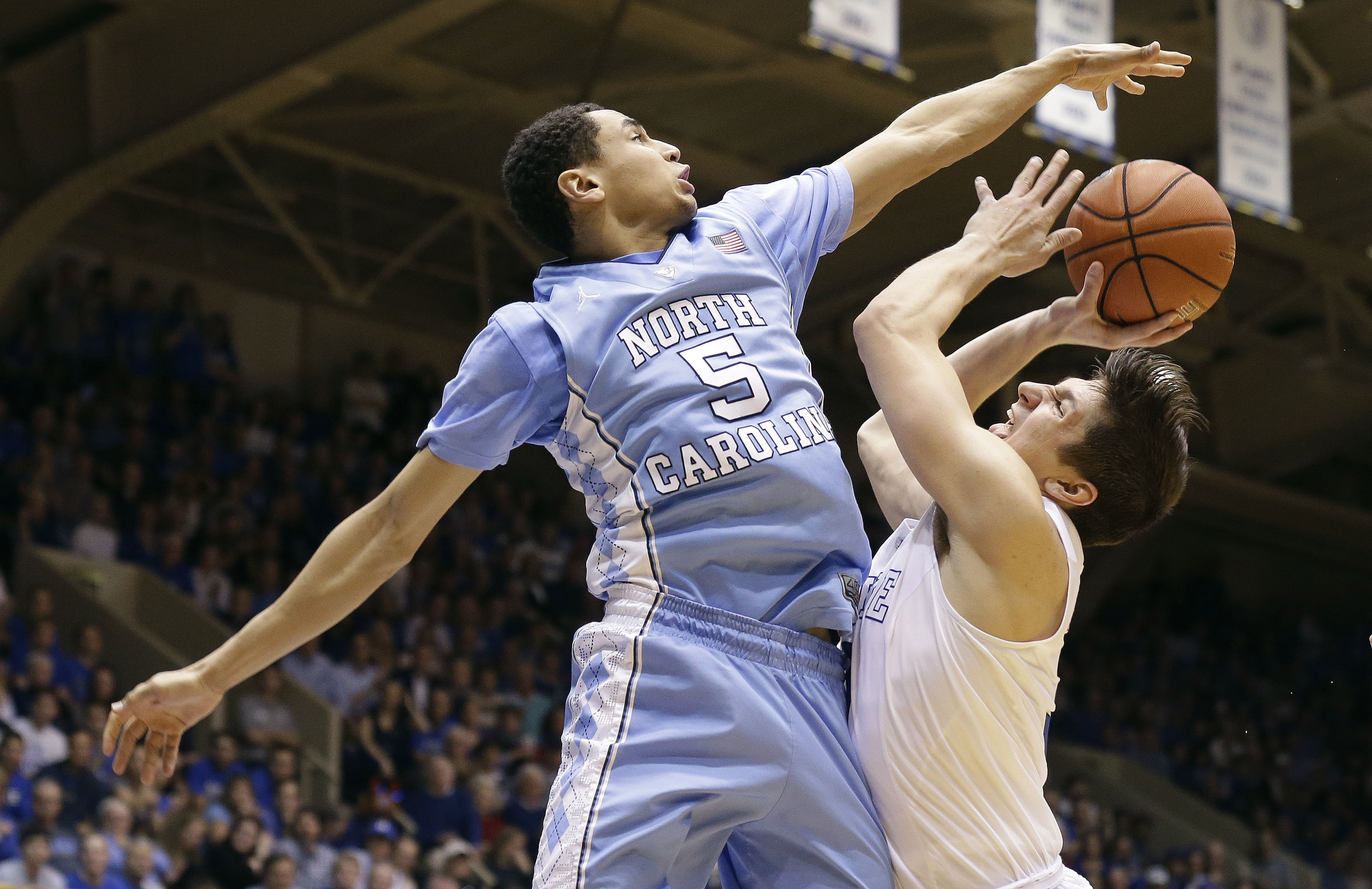 North Carolina's Marcus Paige (5) blocks Duke's Grayson Allen during the second half of an NCAA college basketball game in Durham, N.C., Saturday, March 5, 2016. North Carolina won 76-72. (AP Photo/Gerry Broome)