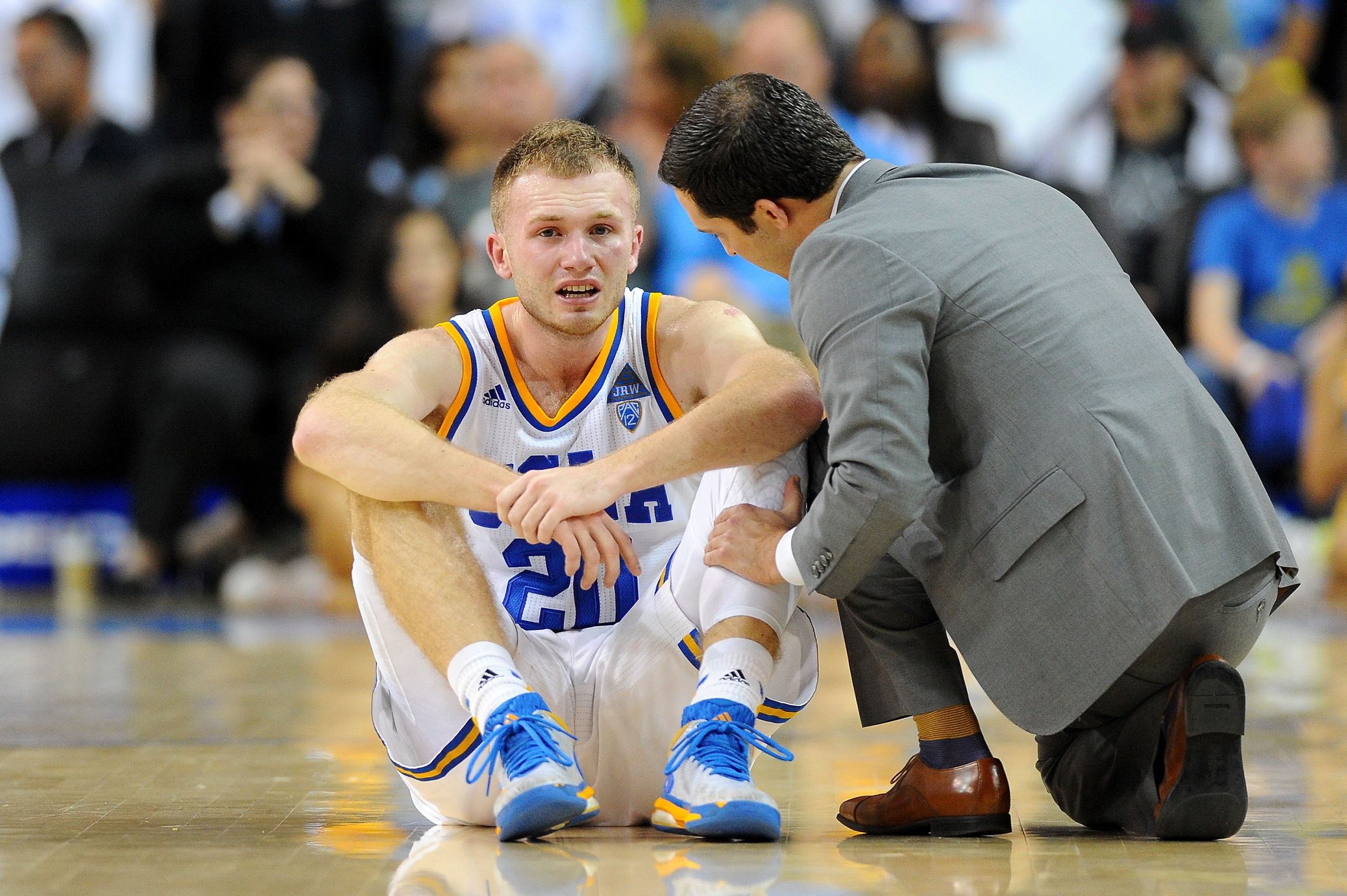 UCLA's Bryce Alford is looked at by a trainer after a collision during an NCAA college basketball game against Oregon State in Los Angeles, Saturday, March 5, 2016. Oregon State beat UCLA 86-82. (AP Photo/Michael Owen Baker)