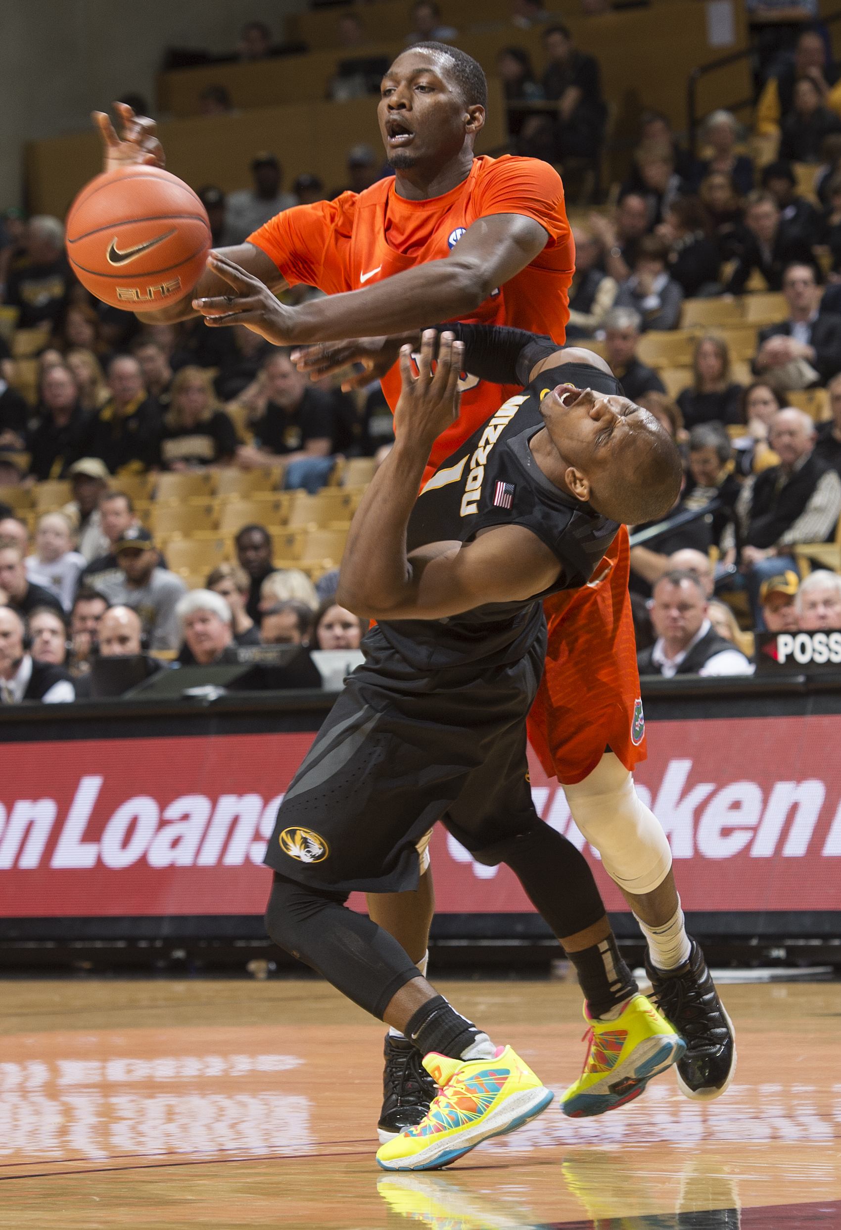 Florida's Dorian Finney-Smith, top, fouls Missouri's Terrence Phillips as he passes the ball during the second half of an NCAA college basketball game Saturday, March 5, 2016, in Columbia, Mo. Florida won 82-72. (AP Photo/L.G. Patterson)