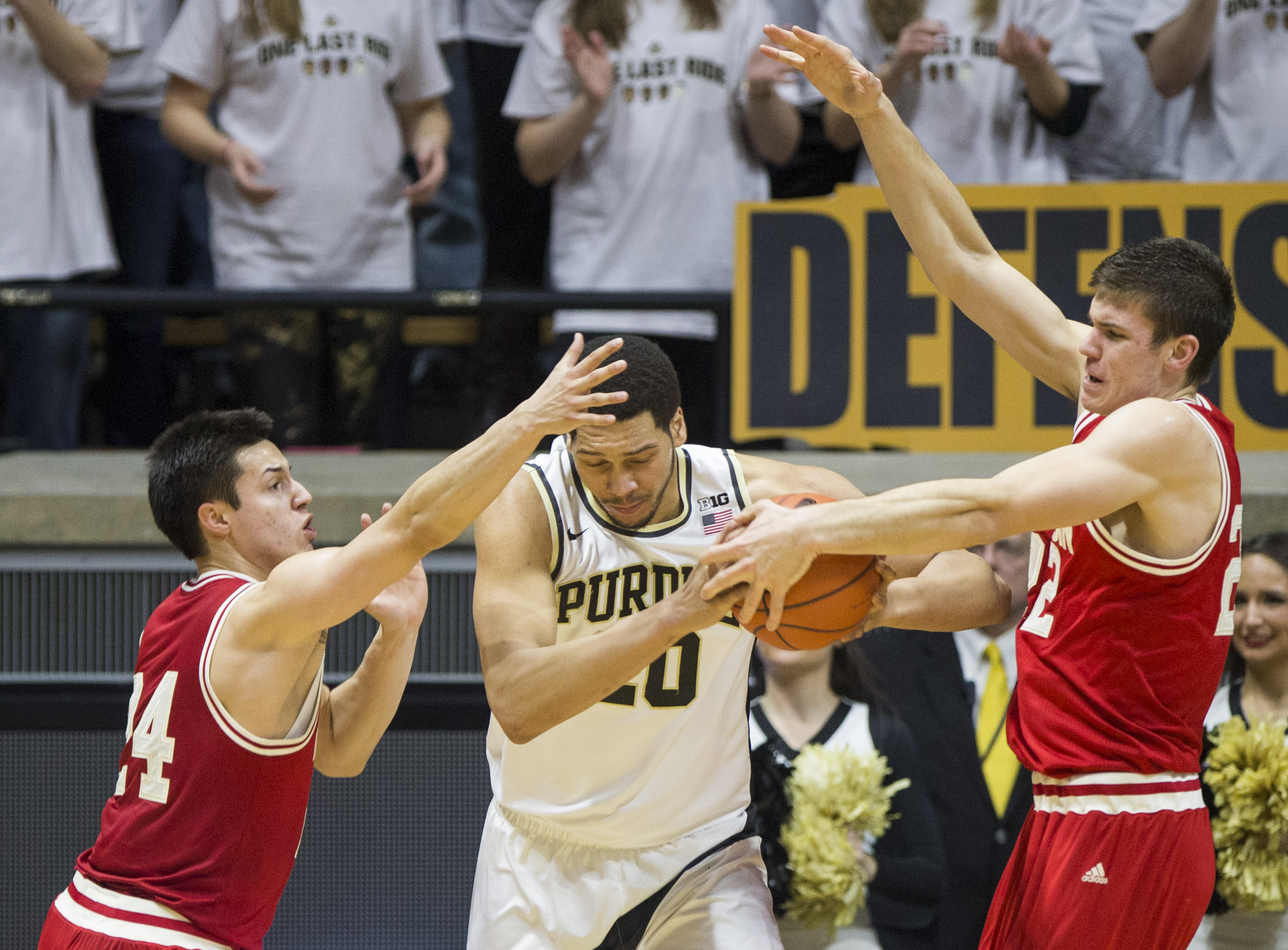 Purdue's A.J. Hammons (20) gets pressure from Wisconsin's BronsonKoenig (24) and EthanHapp (22), right, during the first half of an NCAA college basketball game Sunday, March 6, 2016, in West Lafayette, Ind. (AP Photo/Robert Franklin)