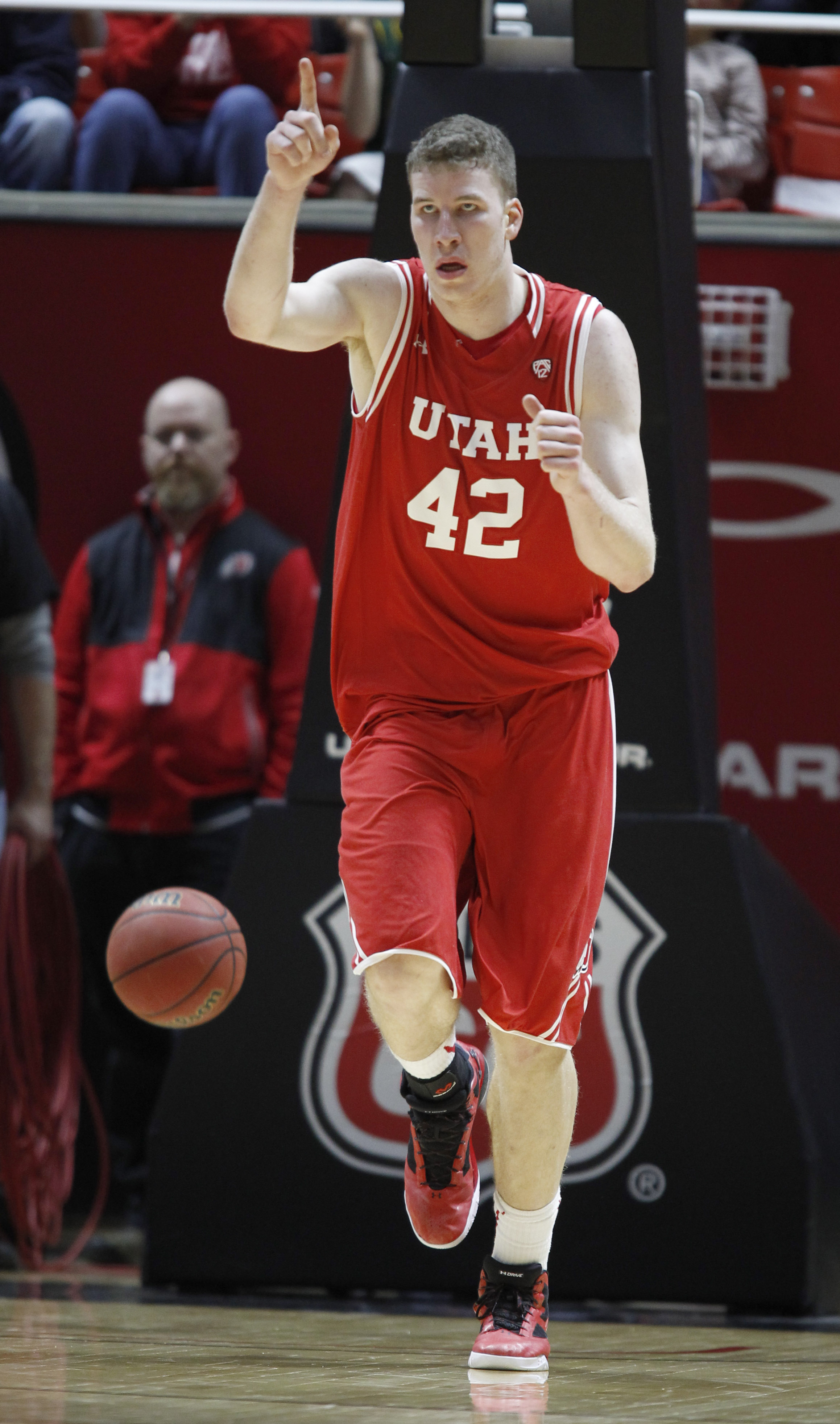 FILE - This Feb. 27, 2016 file photo shows Utah forward Jakob Poeltl (42) celebrating a basket during the second half of an NCAA college basketball game against Arizona in Salt Lake City. Poeltl has been named Pac-12 player of the year and Oregon's Dana A