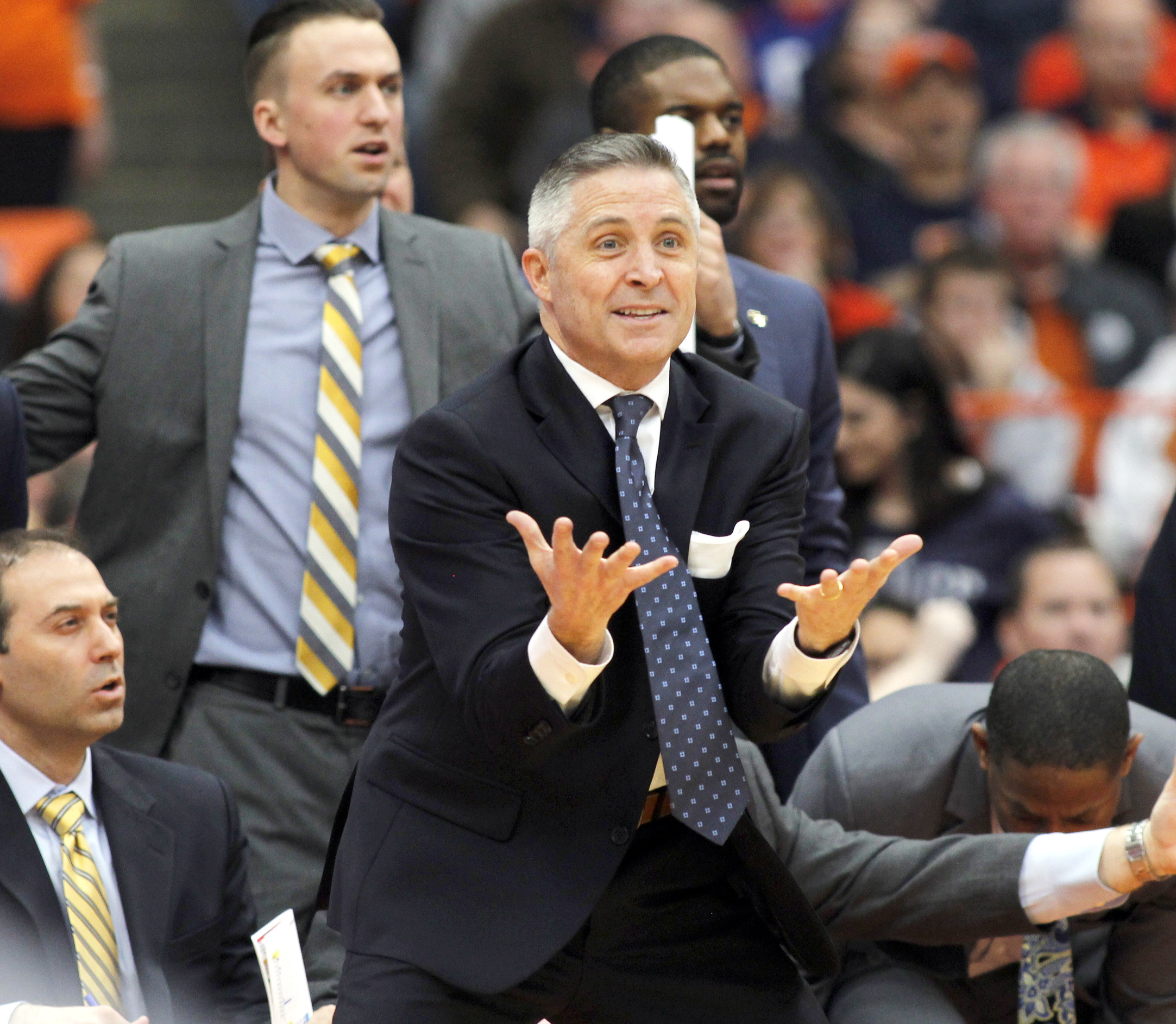 FILE - In this Jan. 30, 2016, file photo, Georgia Tech head coach Brian Gregory, center, reacts in disagreement to a call in the second half of an NCAA college basketball game against Syracuse, in Syracuse, N.Y. Georgia Tech has won five of six entering t