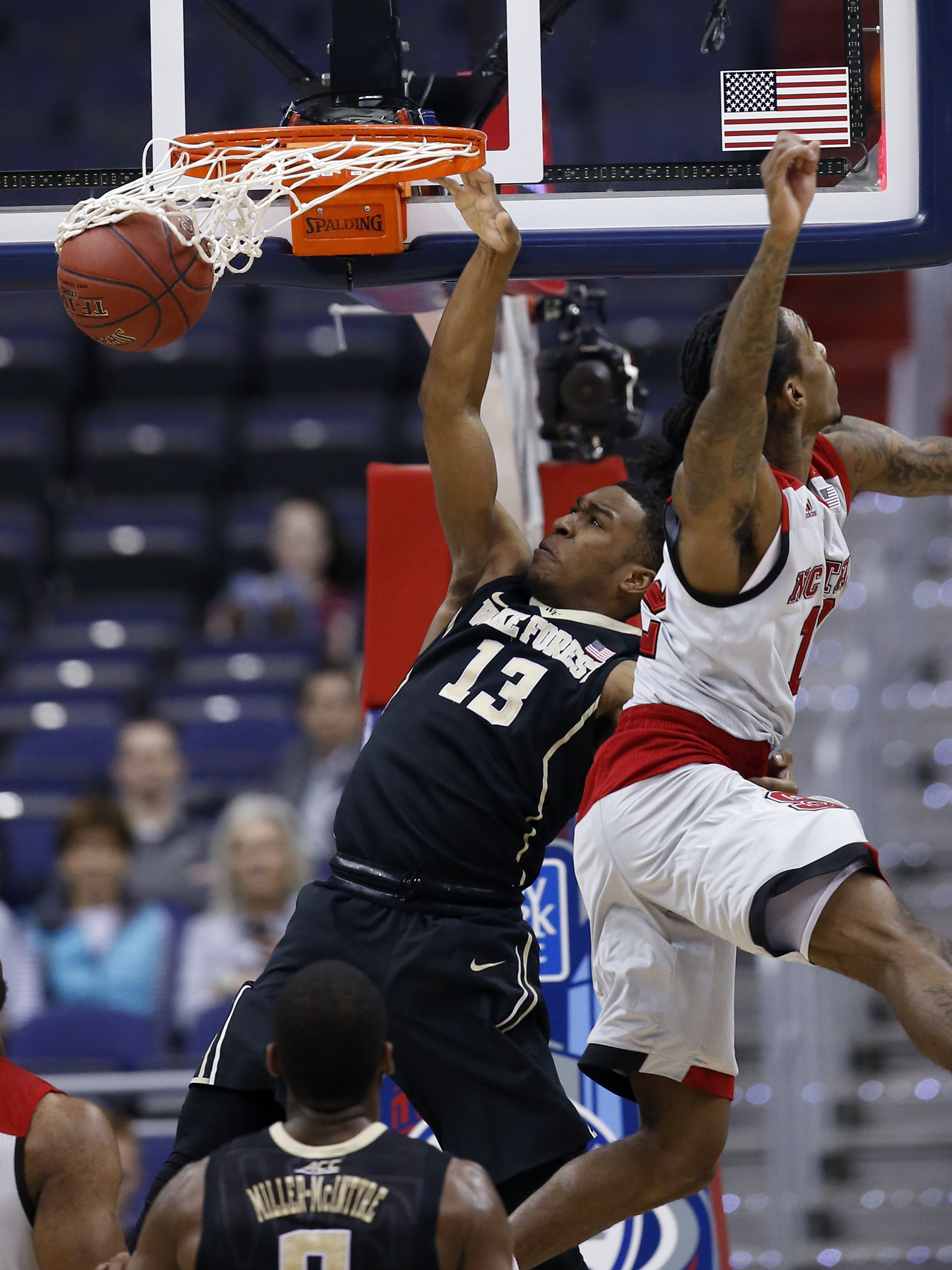 Wake Forest guard Bryant Crawford (13) dunks the ball past North Carolina State guard Anthony Barber (12) during the first half of an NCAA college basketball game in the Atlantic Coast Conference tournament, Tuesday, March 8, 2016, in Washington. (AP Phot