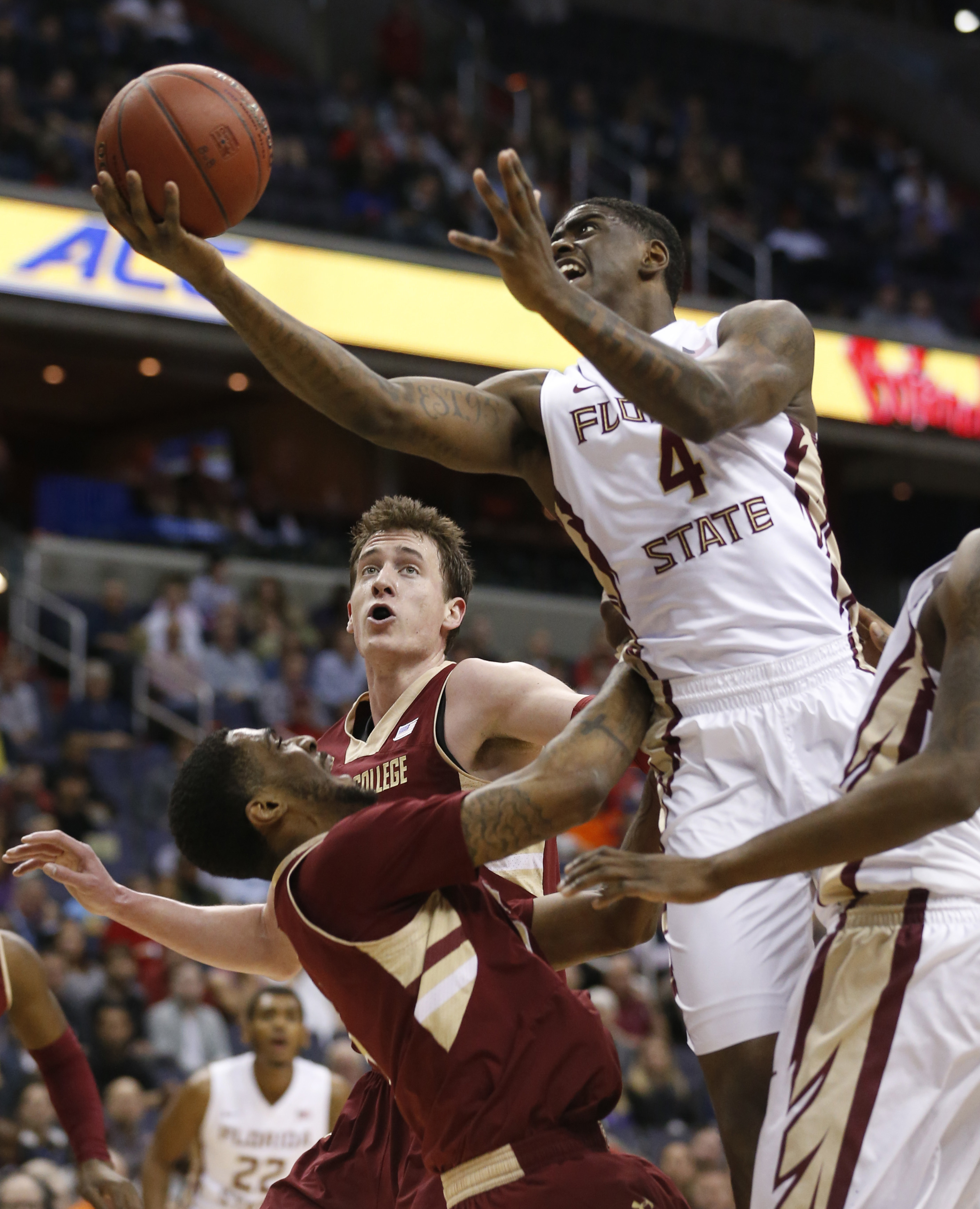 Florida State guard Dwayne Bacon (4) drives to the basket over Boston College forward Garland Owens, left, during the first half of an NCAA college basketball game in the Atlantic Coast Conference tournament in Washington , Tuesday, March 8, 2016. (AP Pho
