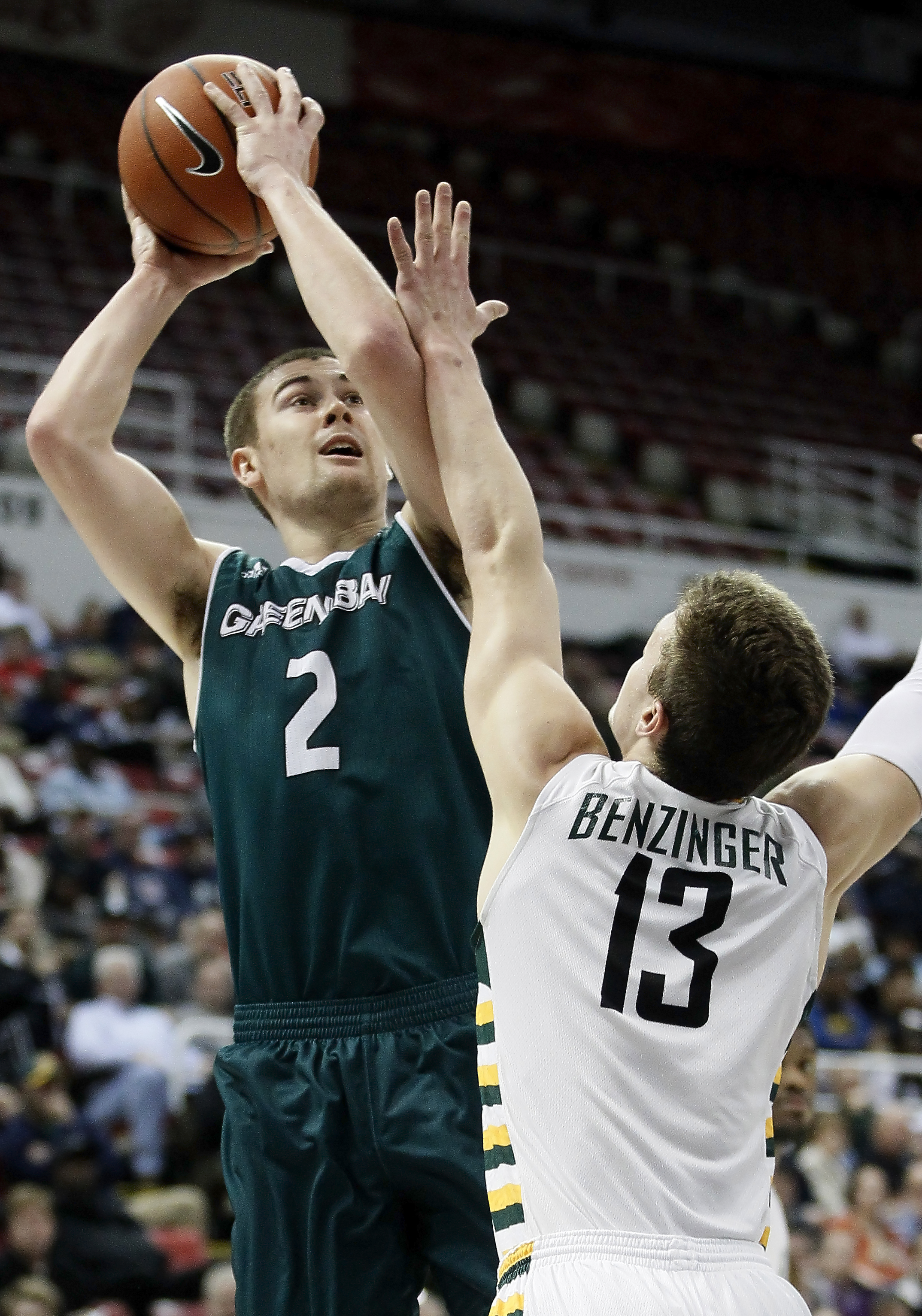 Green Bay's Turner Botz (2) takes a shot against Wright State's Grant Benzinger (13) during the first half of an NCAA college basketball game for the Horizon League men's tournament championship, Tuesday, March 8, 2016, in Detroit. (AP Photo/Duane Burleso