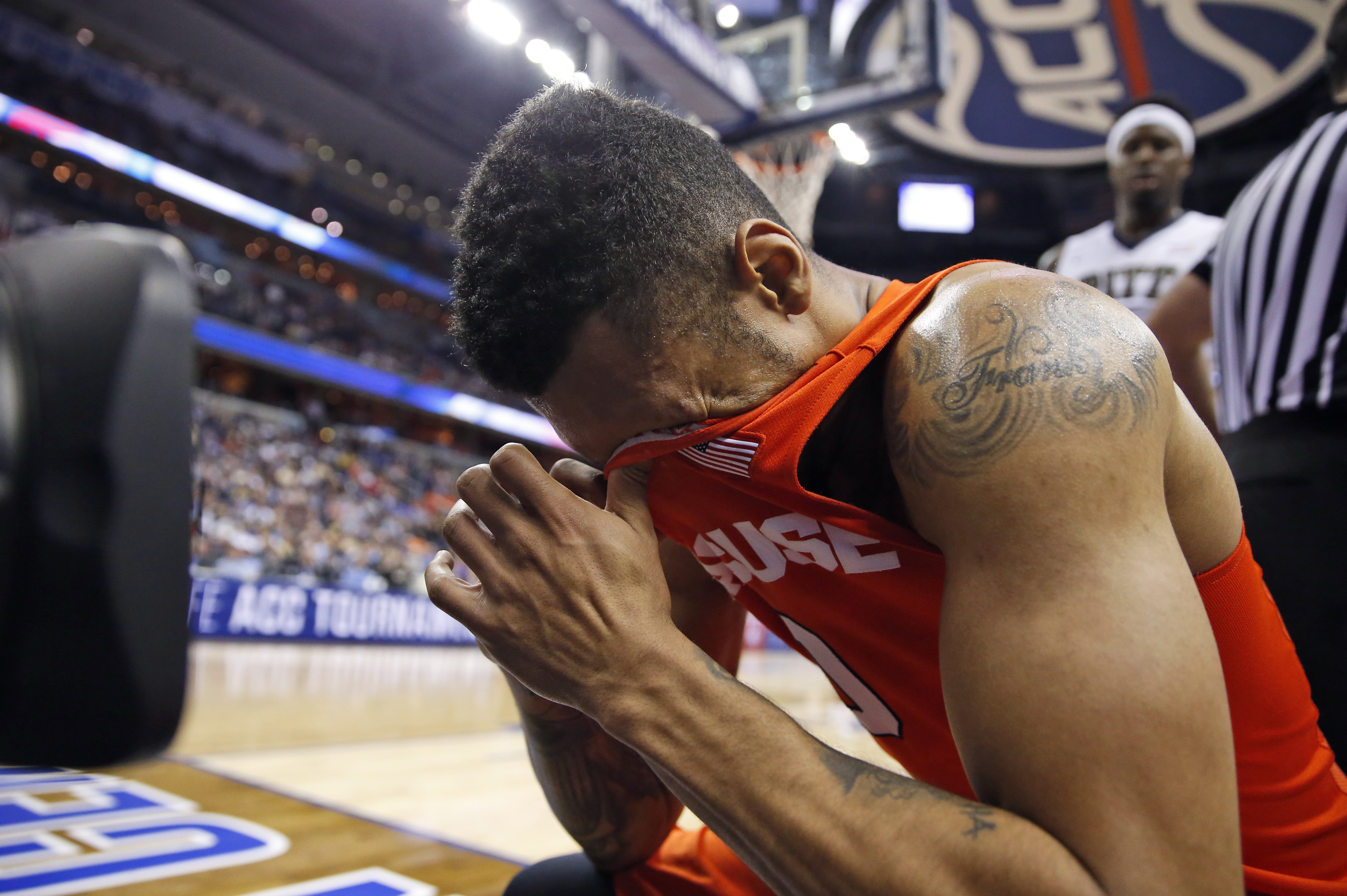 Syracuse forward Michael Gbinije reacts after being hit in the face during the first half of an NCAA college basketball game in the Atlantic Coast Conference tournament against Pittsburgh, Wednesday, March 9, 2016, in Washington.  (AP Photo/Alex Brandon)