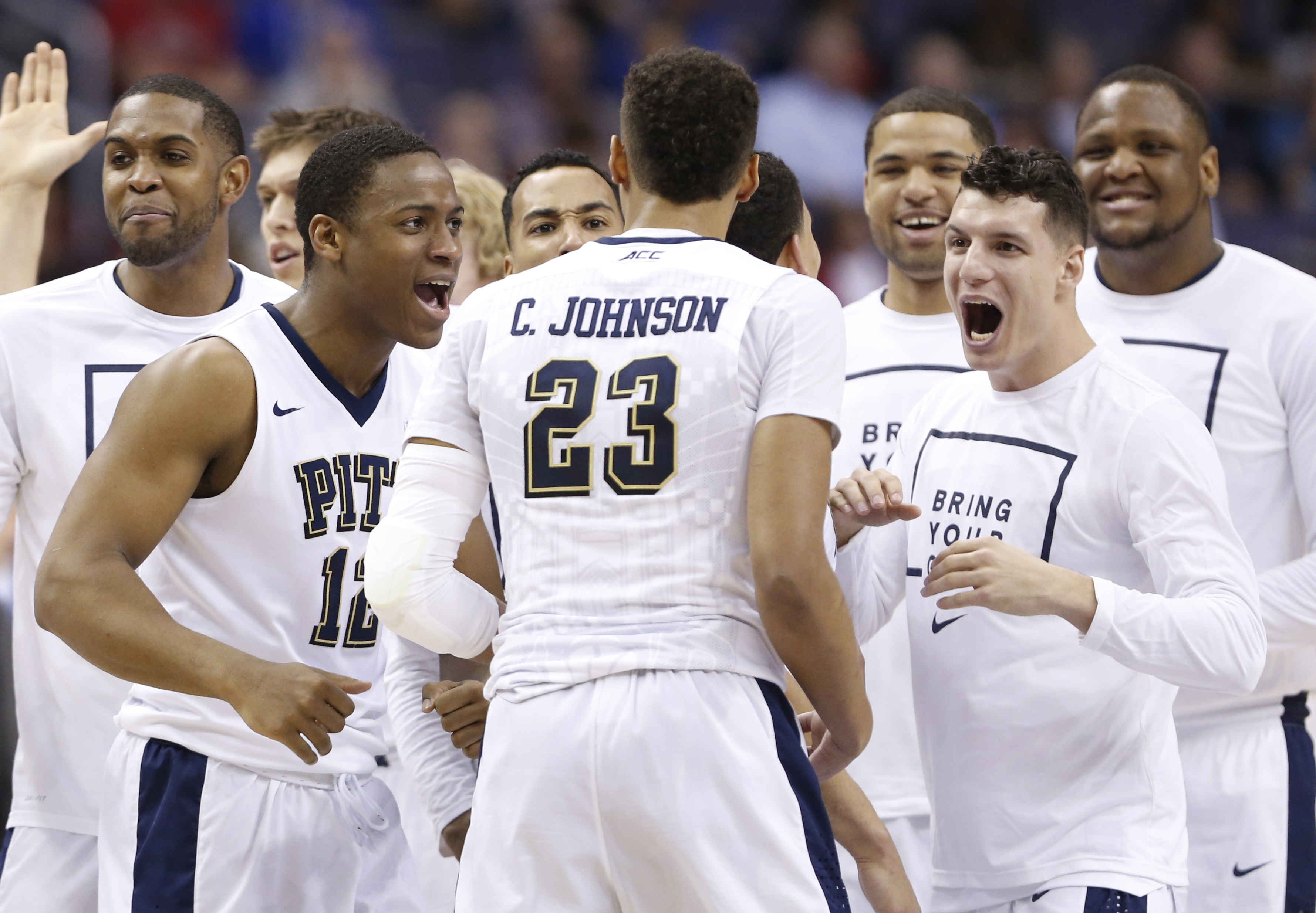 Pittsburgh guard Cameron Johnson (23) is welcomed to the bench after a score during the second half of an NCAA college basketball game in the Atlantic Coast Conference tournament in Washington , Wednesday, March 9, 2016. (AP Photo/Steve Helber)