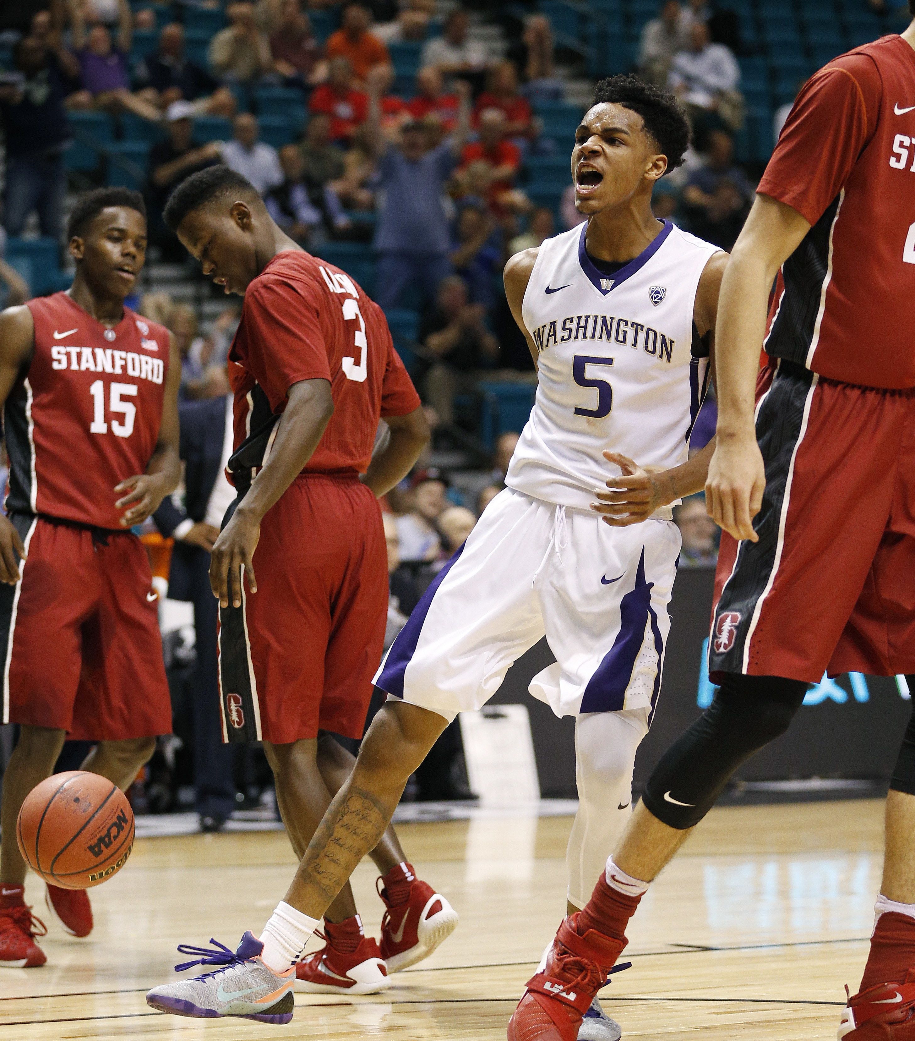 Washington guard Dejounte Murray (5) reacts after scoring against Stanford during the first half of an NCAA college basketball game in the first round of the Pac-12 tournament Wednesday, March 9, 2016, in Las Vegas. (AP Photo/John Locher)