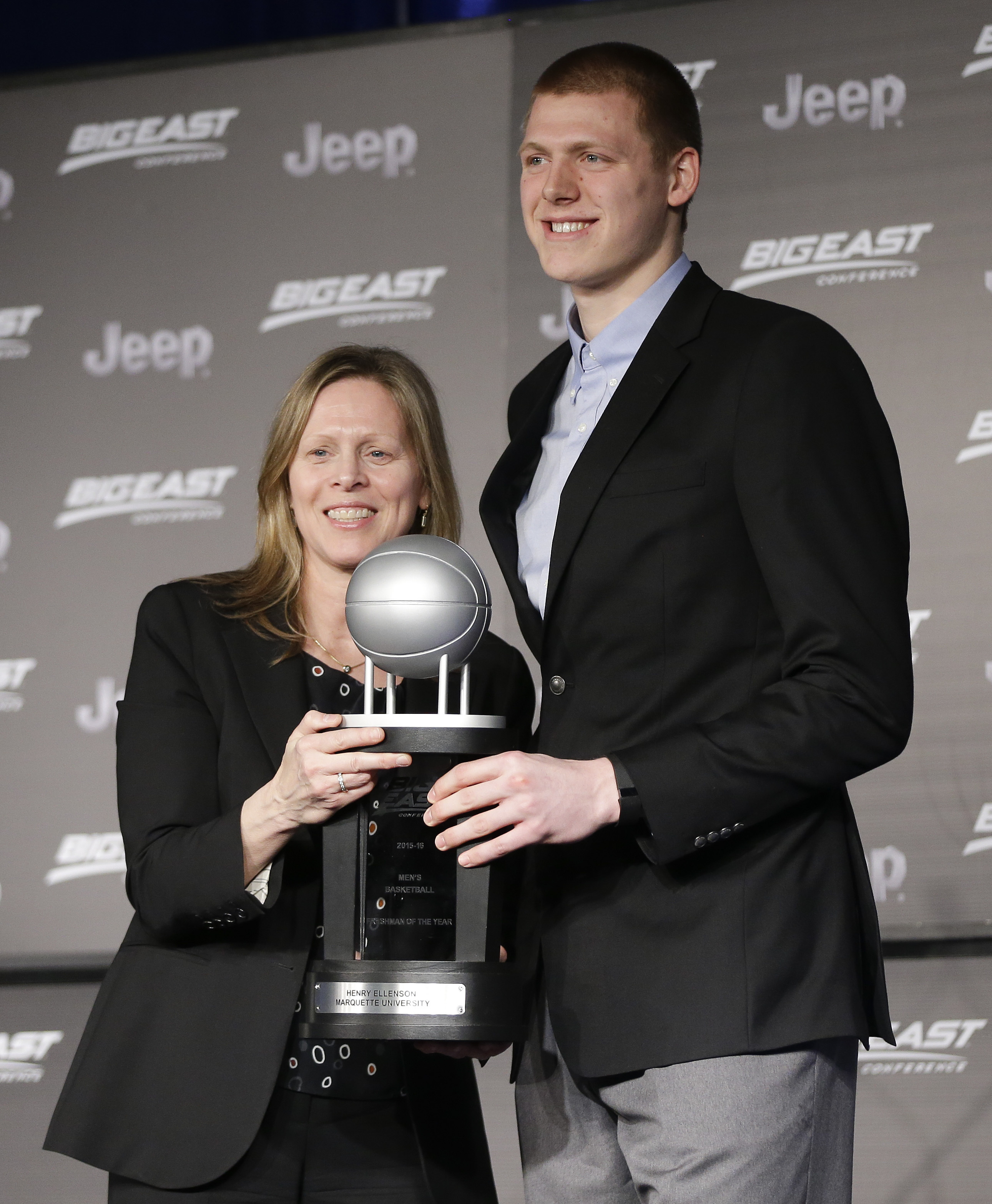 Marquette forward Henry Ellenson, right, poses for photos with Big East Commissioner Val Ackerman after receiving the award for conference freshman of the year, Wednesday, March 9, 2016, in New York. (AP Photo/Julie Jacobson)