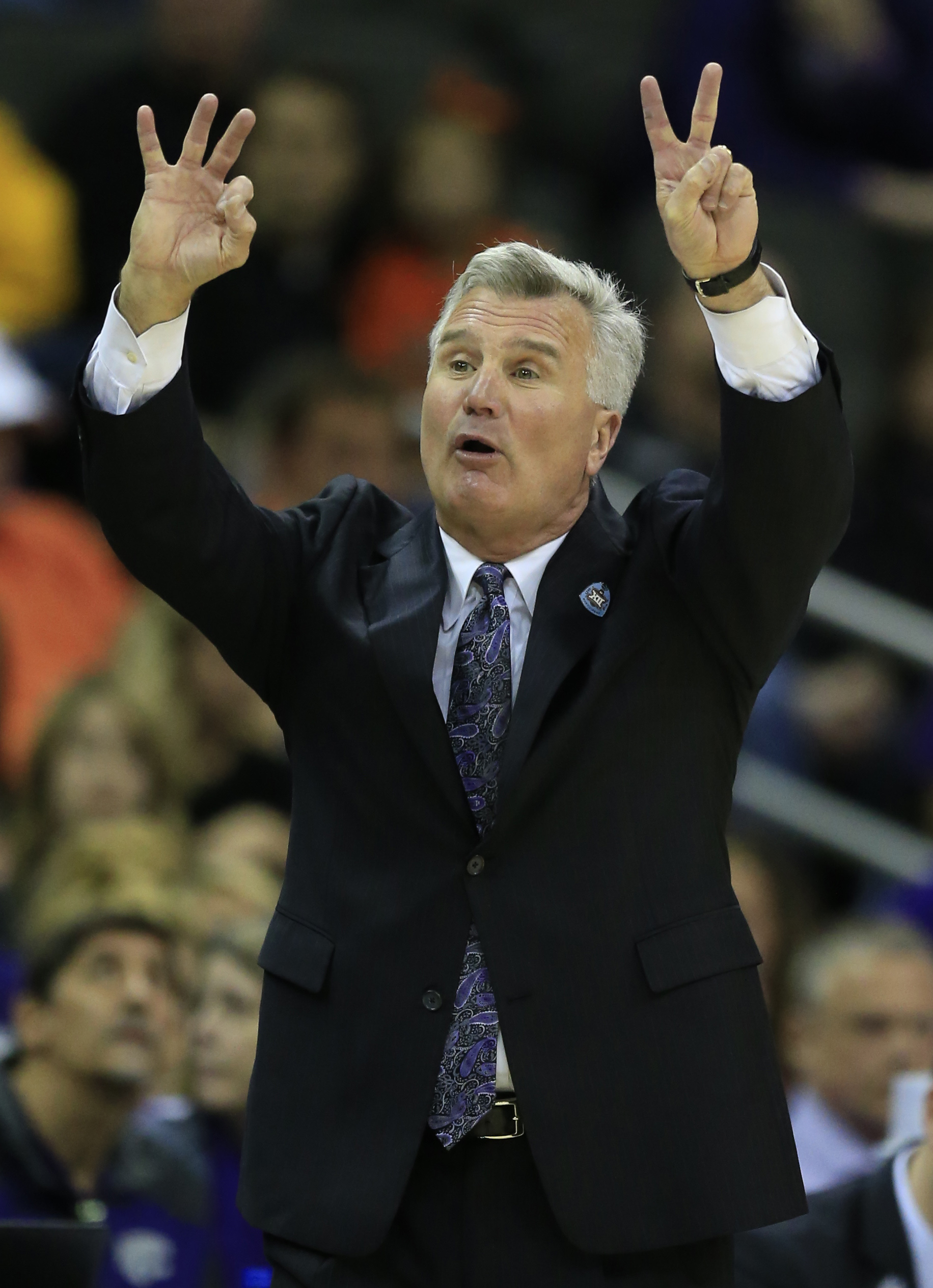 Kansas State head coach Bruce Weber signals a play during the first half of an NCAA college basketball game against Oklahoma State in the first round of the Big 12 conference tournament in Kansas City, Mo., Wednesday, March 9, 2016. (AP Photo/Orlin Wagner